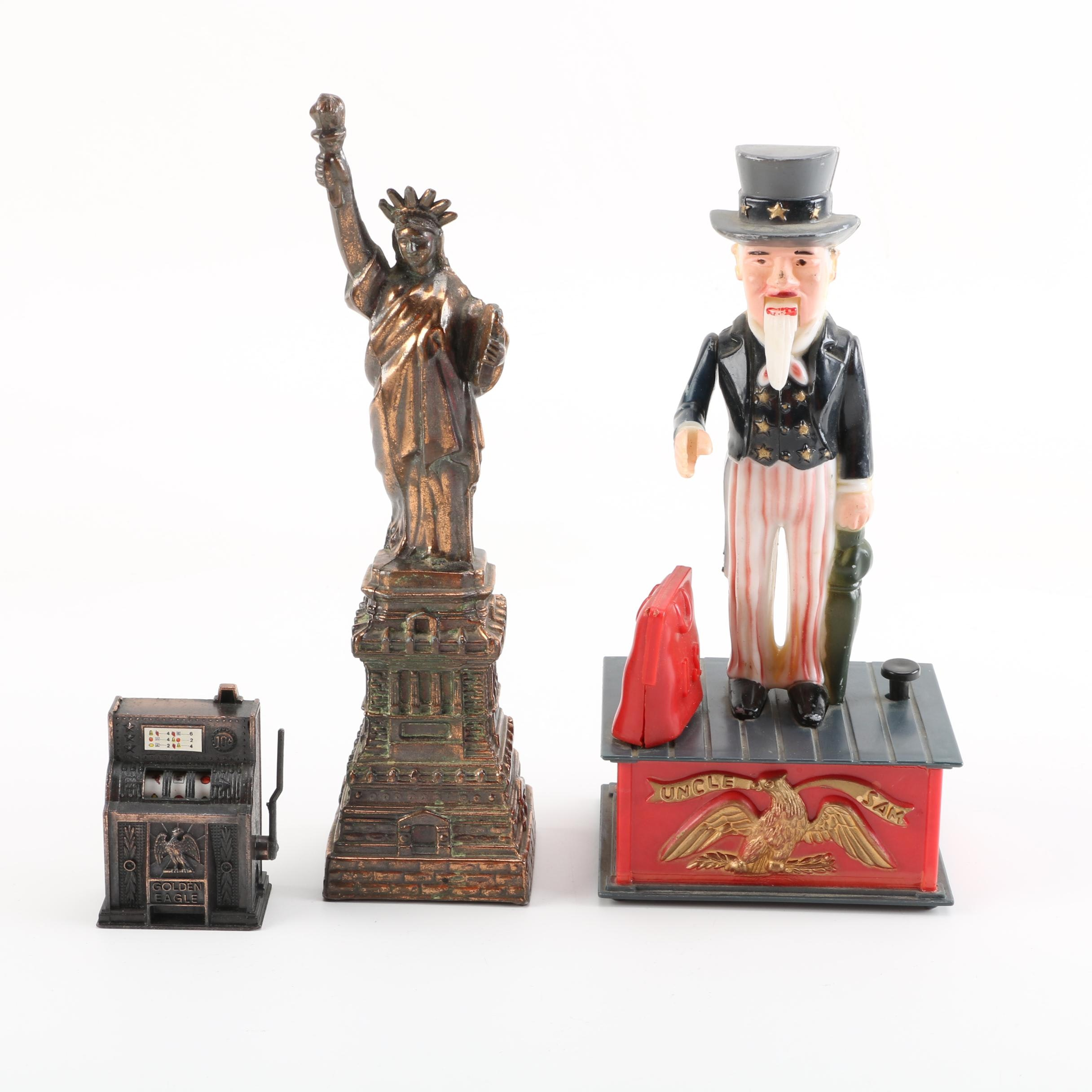 Slot Machine Pencil Sharpener, Lady Liberty Figurine, and Uncle Sam Coin Bank