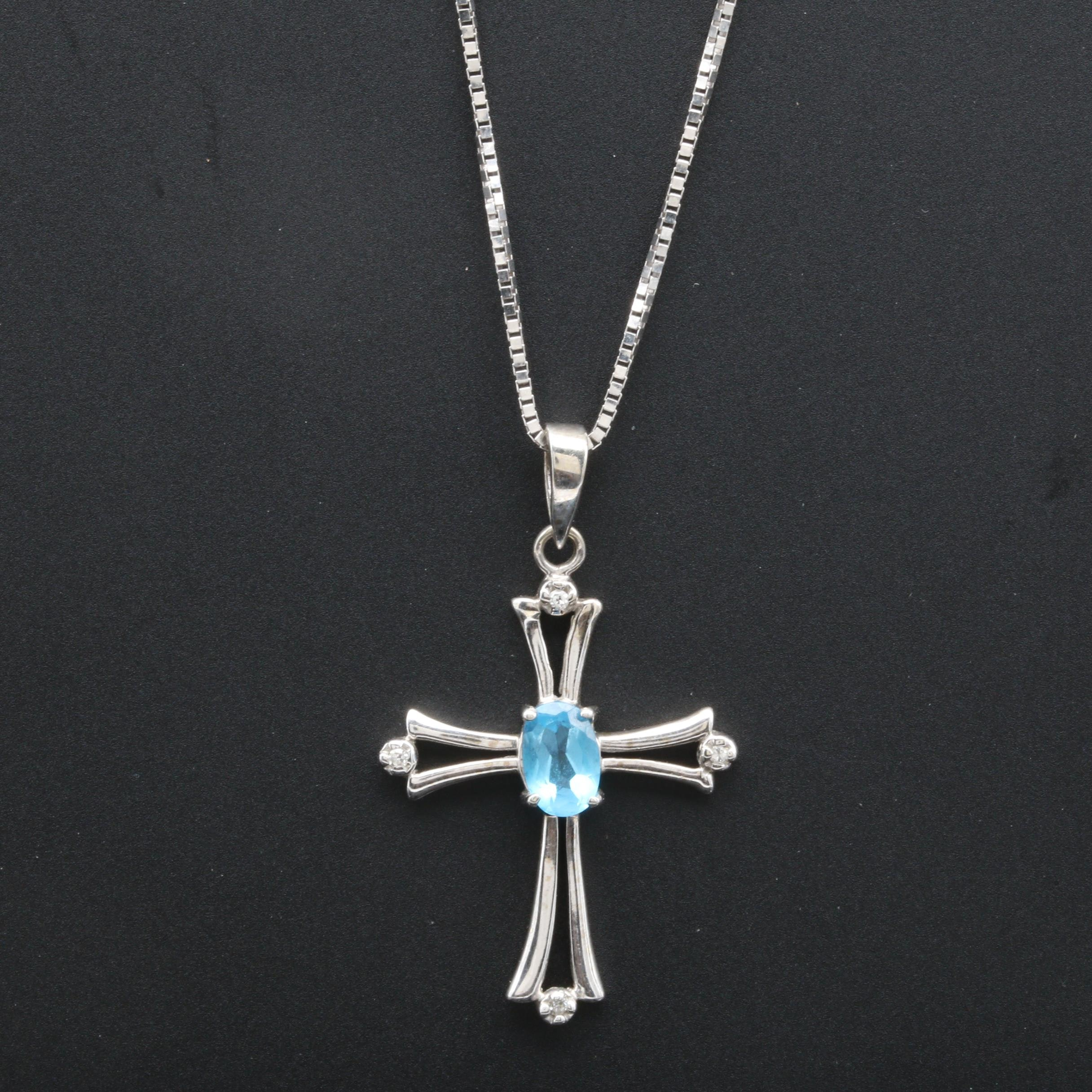 10K and 14K White Gold Blue Topaz and Diamond Cross Necklace