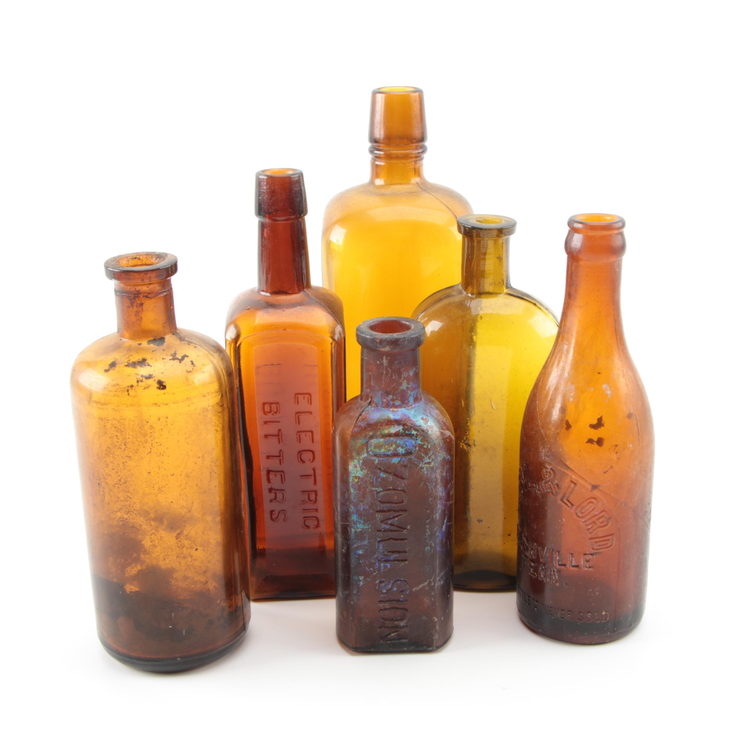Collection of Six Antique Brown Glass Bottles
