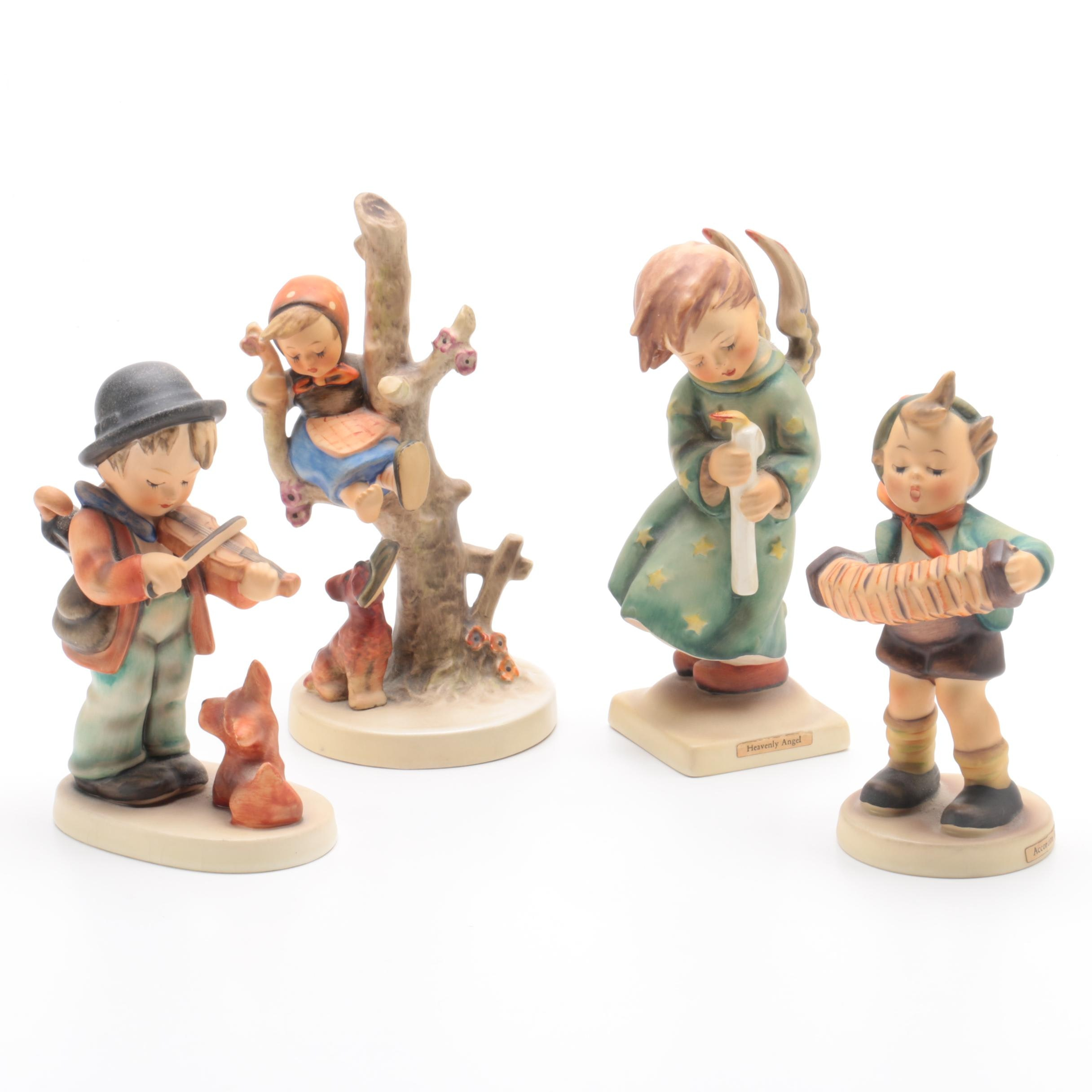 "Hummel Figurines including ""Puppy Love"", ""Heavenly Angel"" and ""Accordion Boy"""