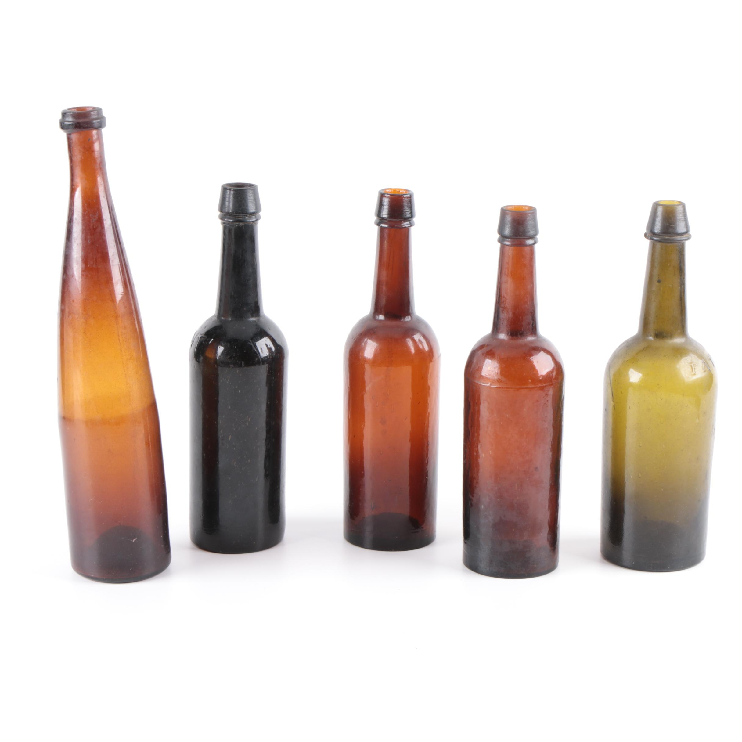 Five Glass Bottles, Early 20th-Century