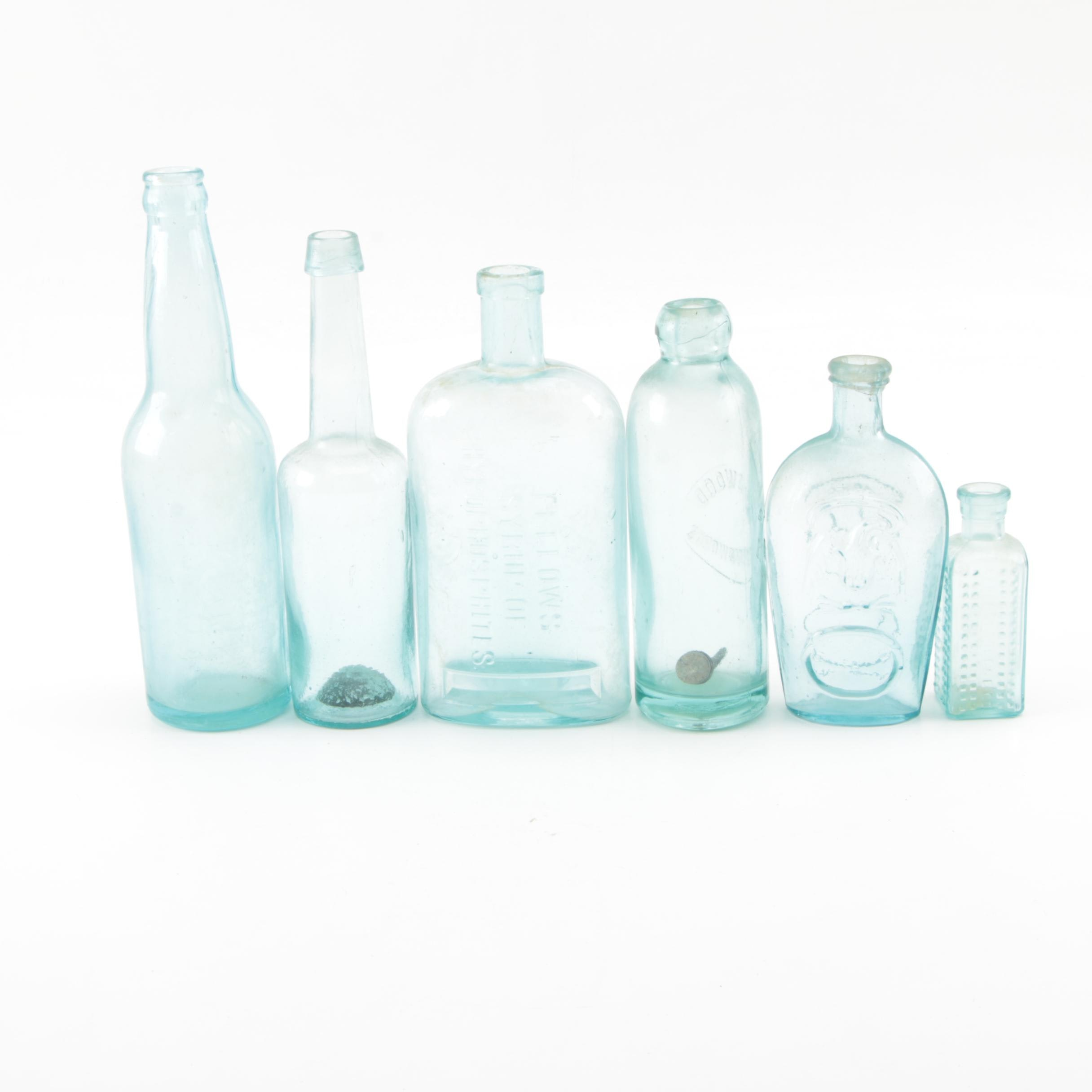 Six Vintage Glass Apothecary Bottles