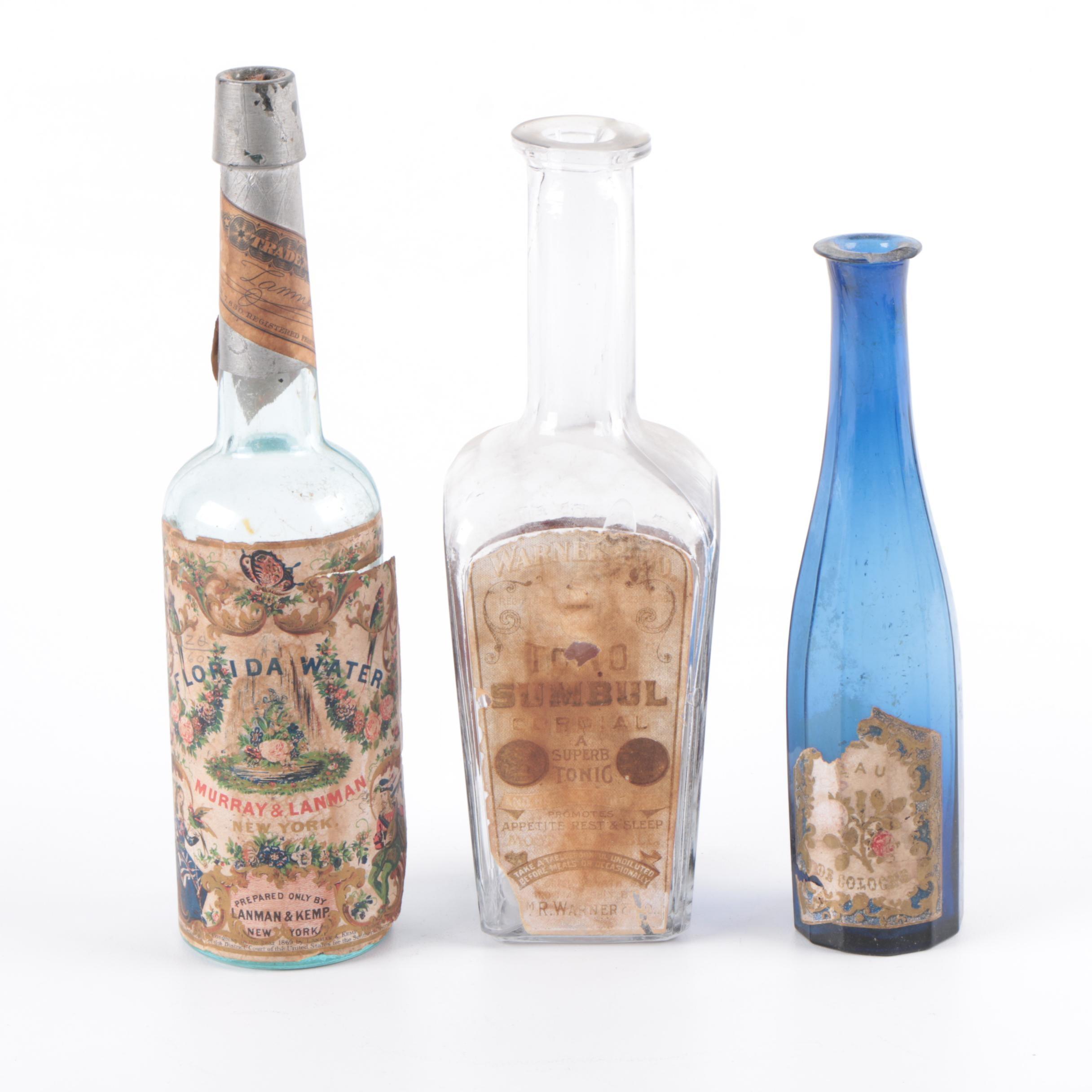 Three Antique Glass Apothecary Jars