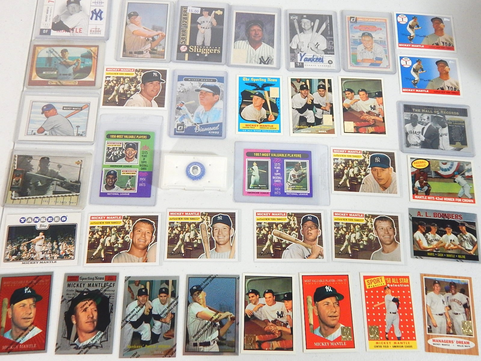 Mickey Mantle Baseball Card Lot and 1969 Pin with 1975 MVP Cards, Archives