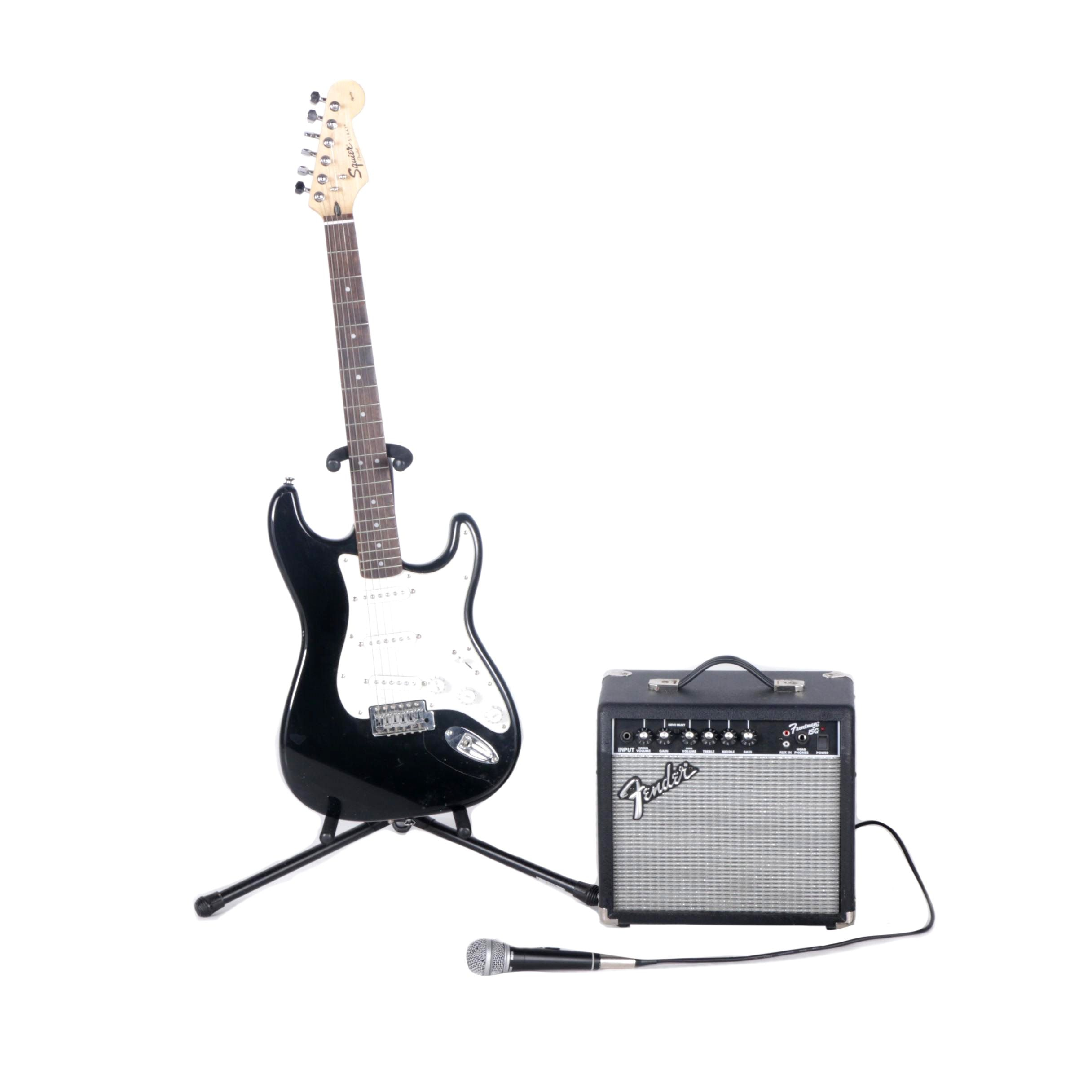 Squier Strat Guitar, Stand and Frontman 15 G Amplifier