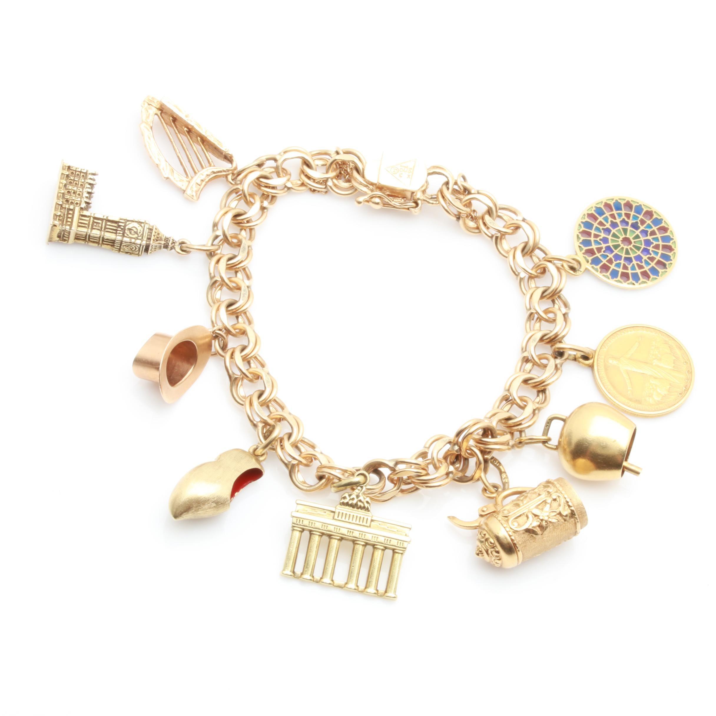 18K,14K and 9K Yellow Gold Charm Bracelet Including  Plique-à-Jour Enamel