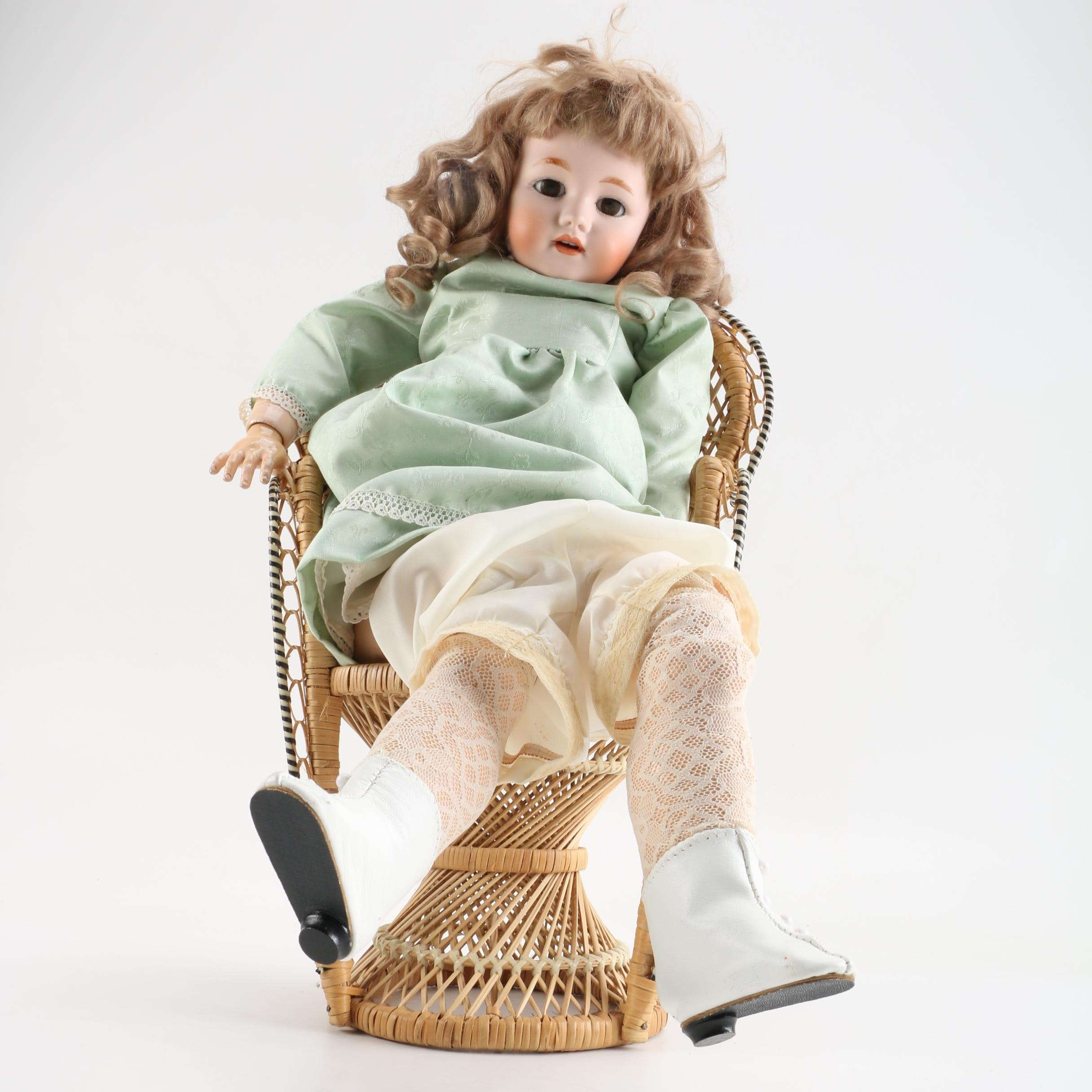 Vintage Doll and Wicker Chair