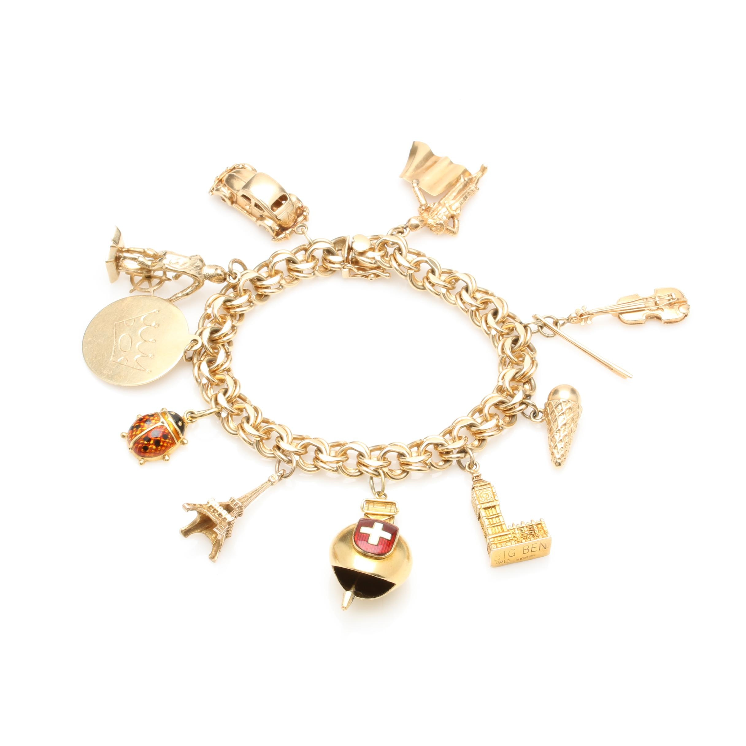 14K Yellow Gold Bracelet With Mixed Gold Charms