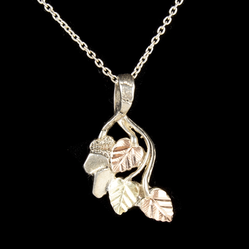 Sterling Silver Floral Pendant Necklace With Yellow and Rose Gold Plated Accents