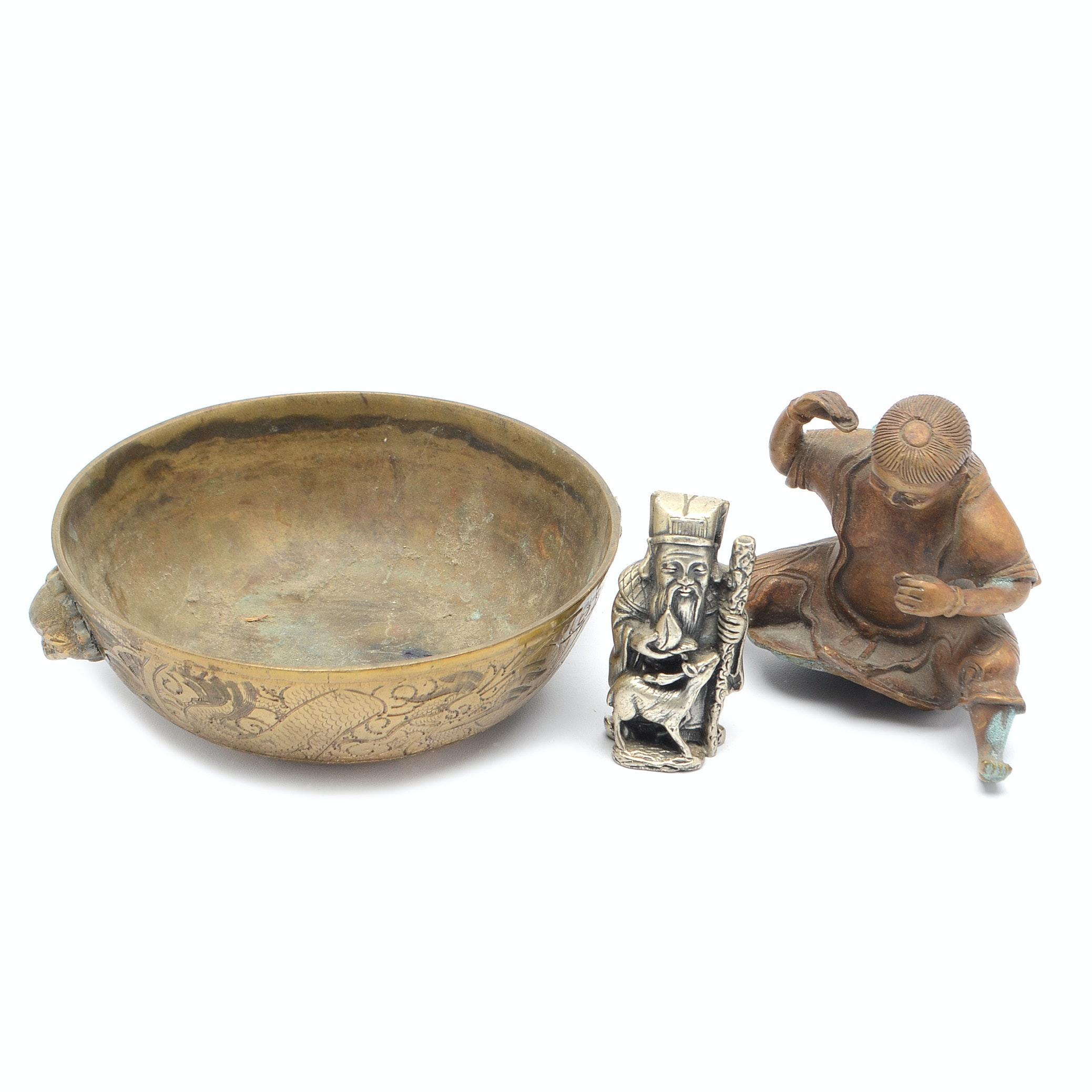 Decorative Figurines Featuring Peltro