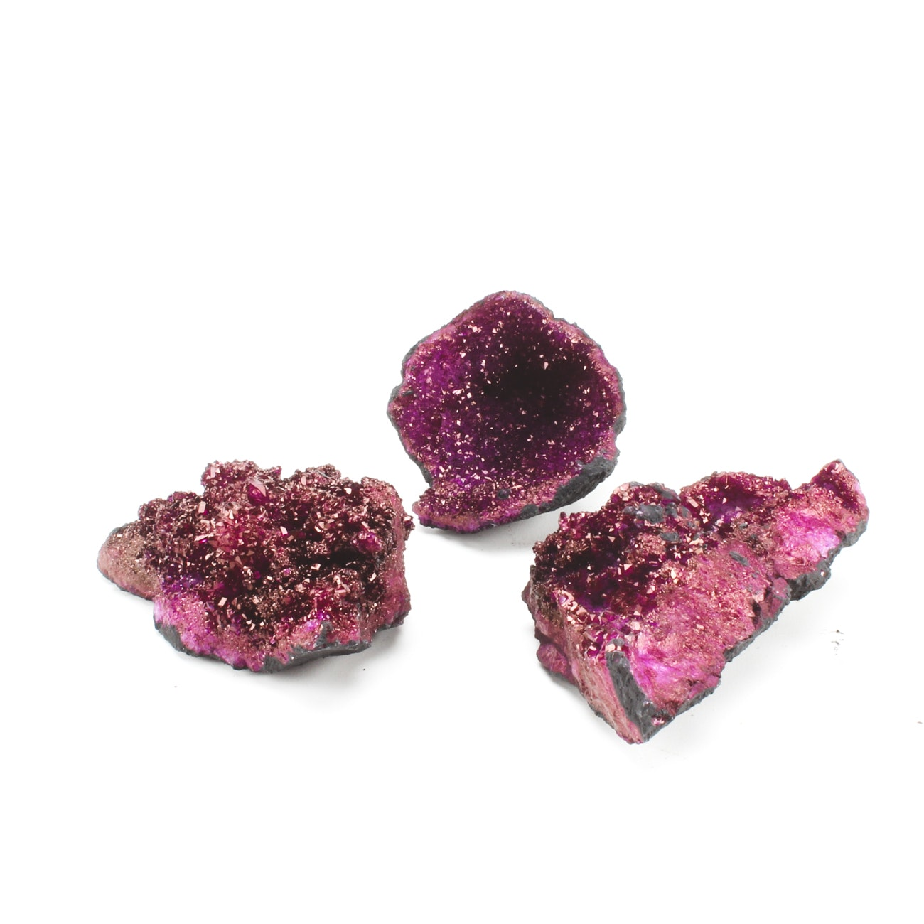 Grouping of Three Purple Dyed Quartz Crystal Moroccan Geodes