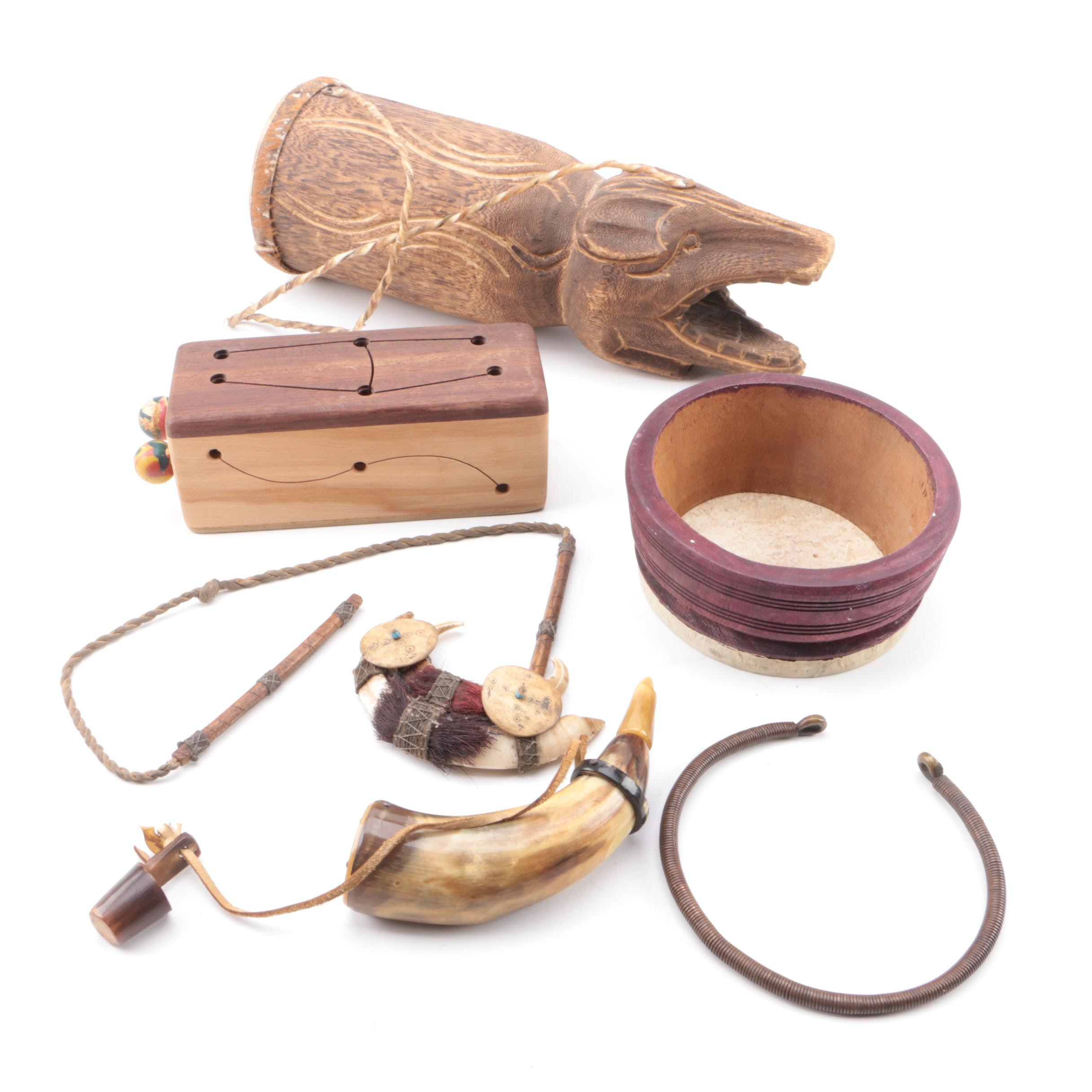 C. White Hand Carved Tongue Drum, Powder Horn, Boar Tusk Necklace and More