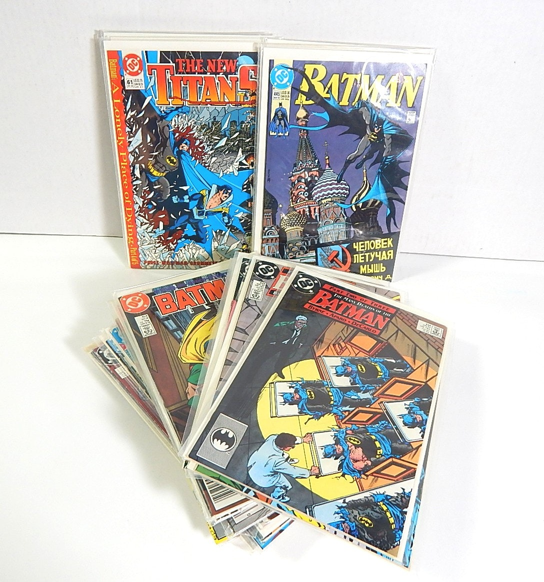 "Collection of 1990s DC Comics with ""Batman"" and ""The New Titans"""