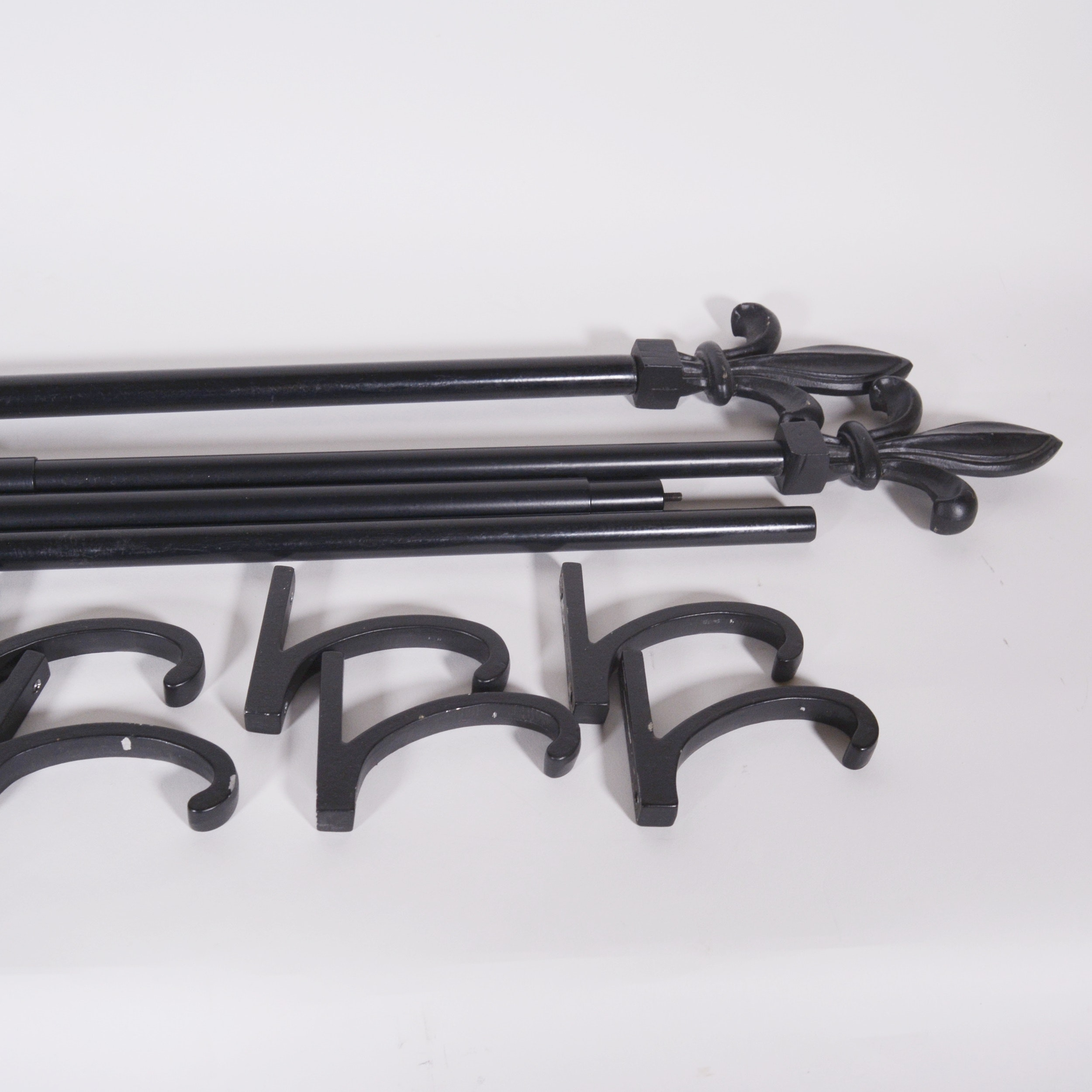 Black Metal Curtain Rods With Fleur-de-Lis Finials and Brackets