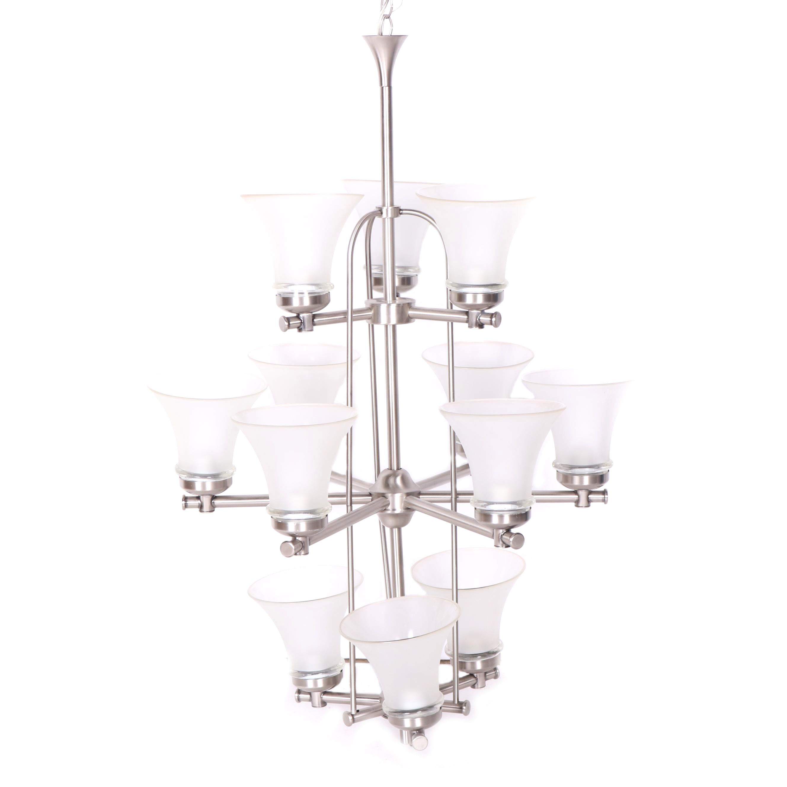 Brushed stainless steel chandelier with frosted glass shades