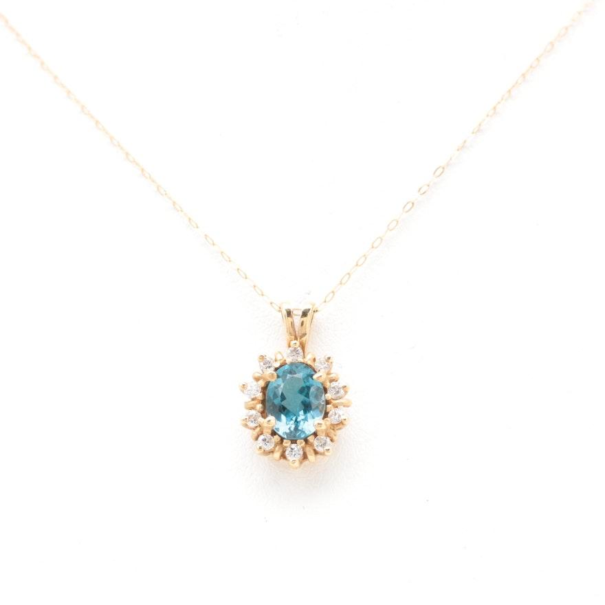 14k yellow gold blue topaz and diamond pendant necklace ebth 14k yellow gold blue topaz and diamond pendant necklace mozeypictures Choice Image