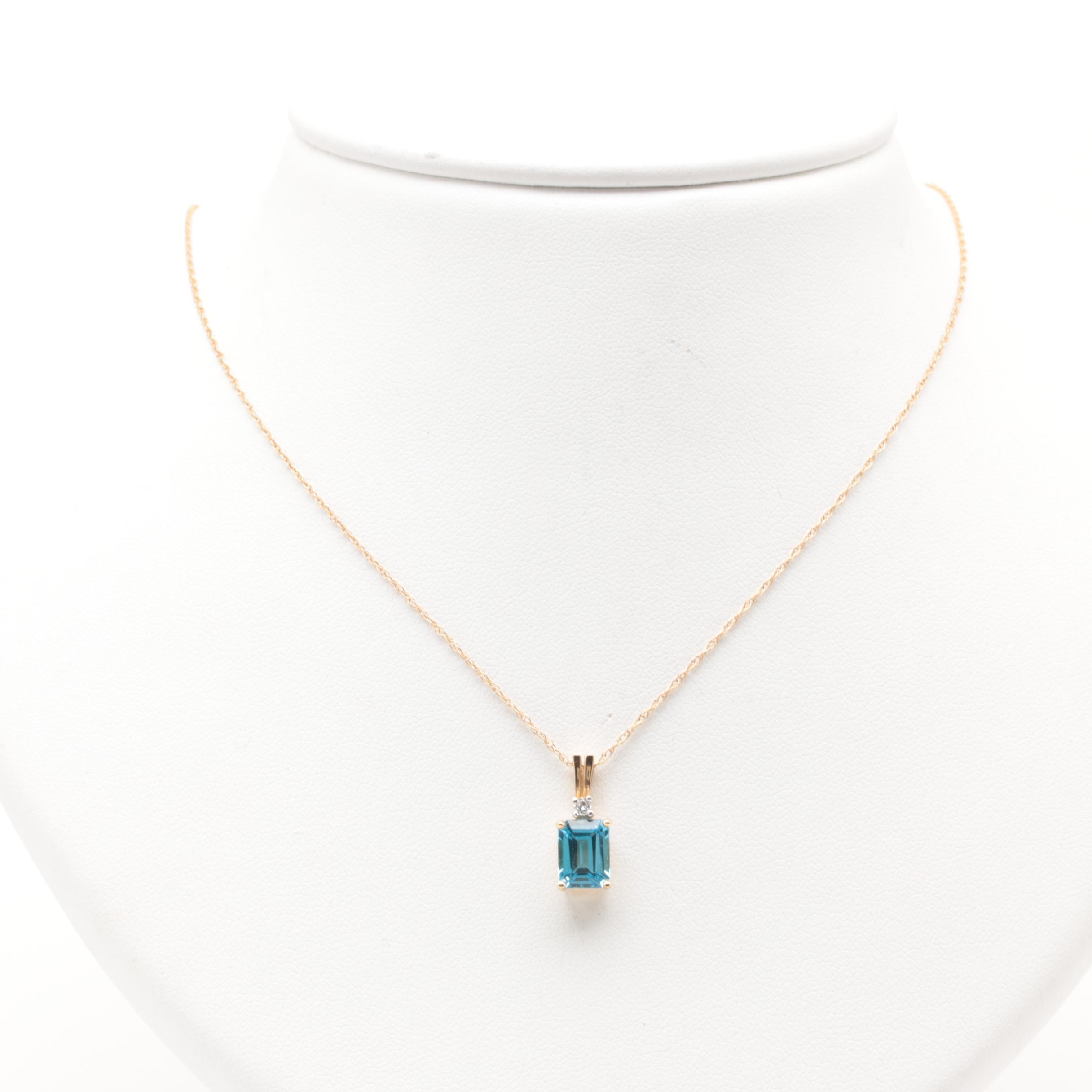 14K Yellow Gold Blue Topaz and Diamond Pendant Necklace with 14K White Gold