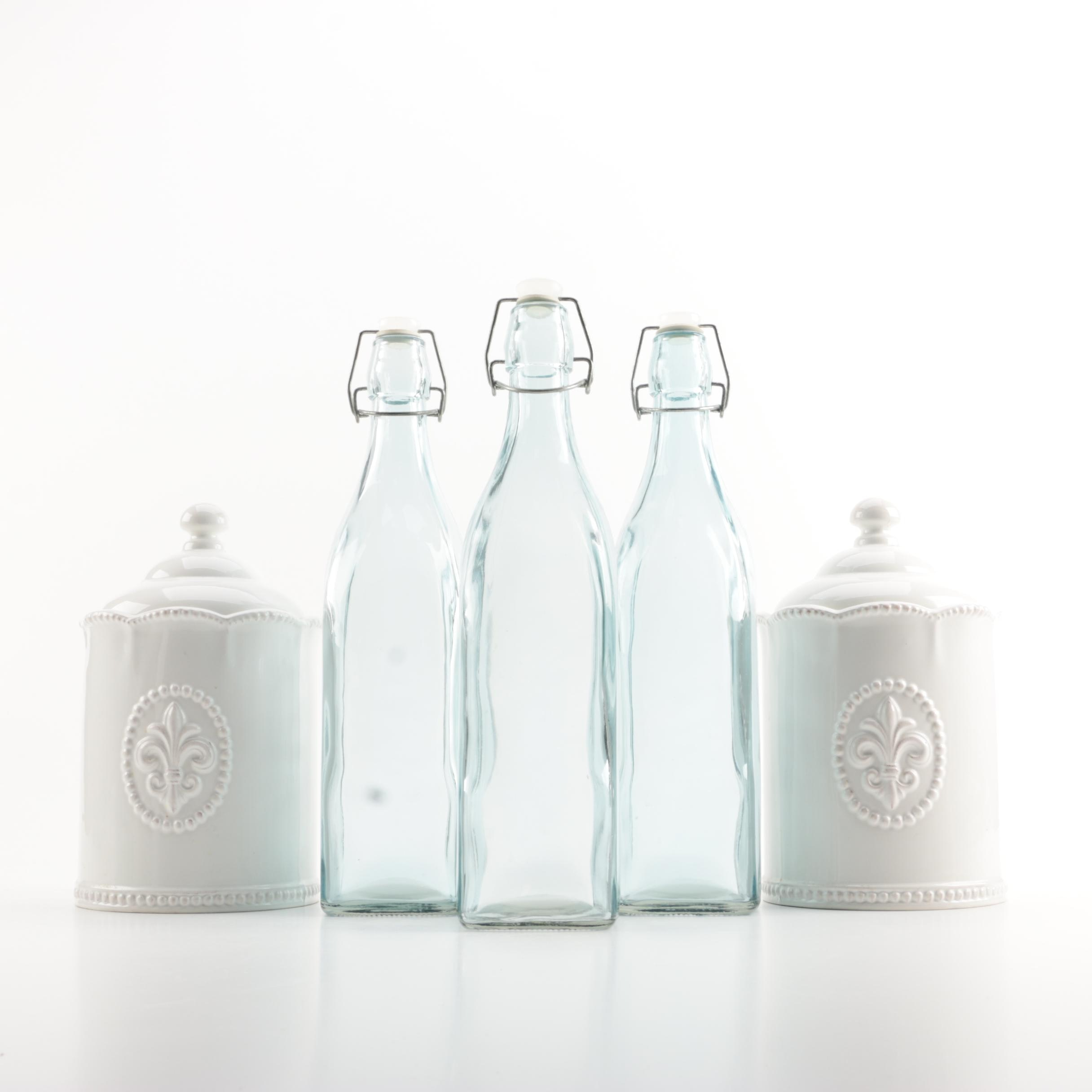 Ivory Glazed Ceramic Canisters and Clear Glass Bottles
