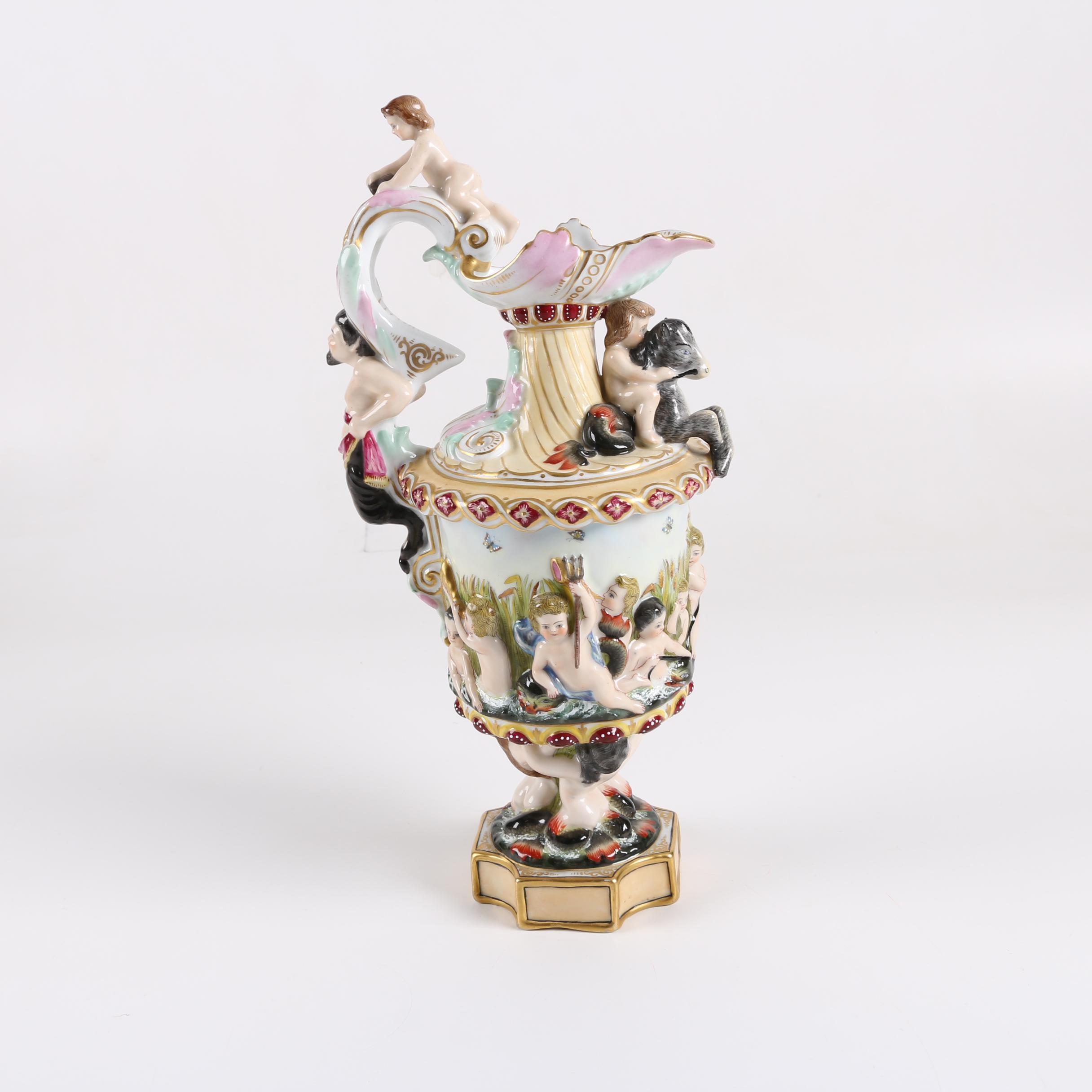 Capodimonte Style Porcelain Ewer with Figural Cherub Motif
