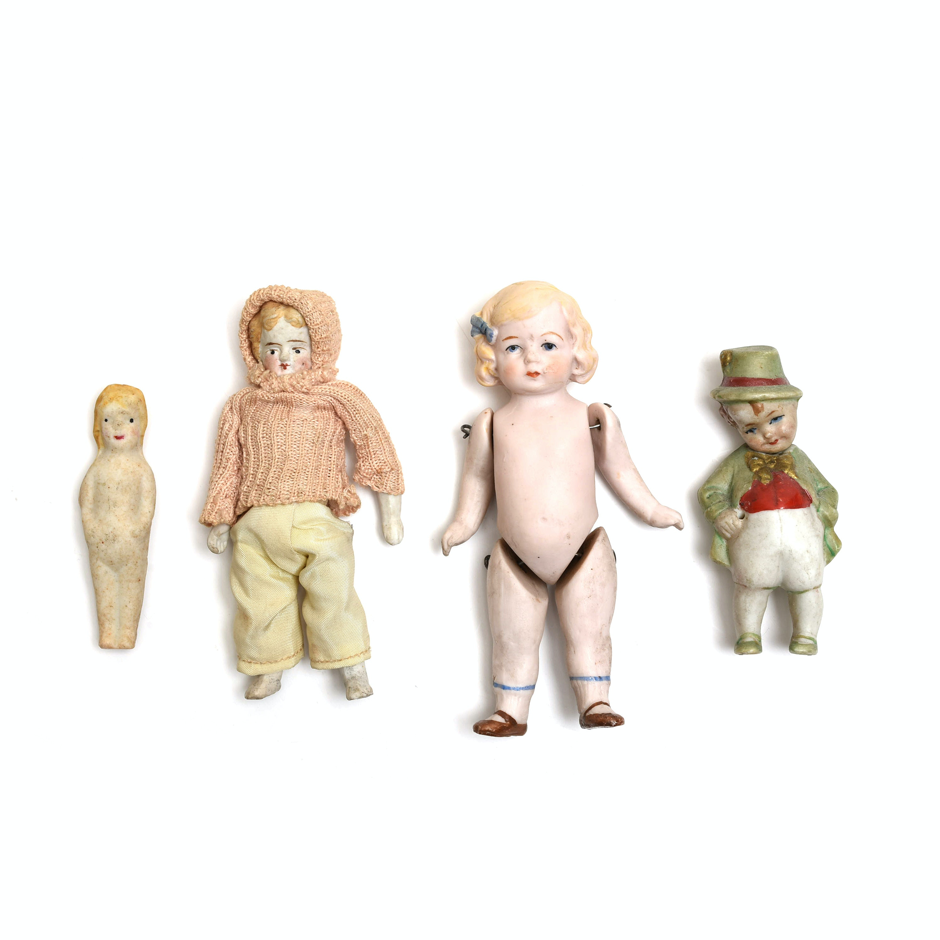 Four Small Bisque Dolls