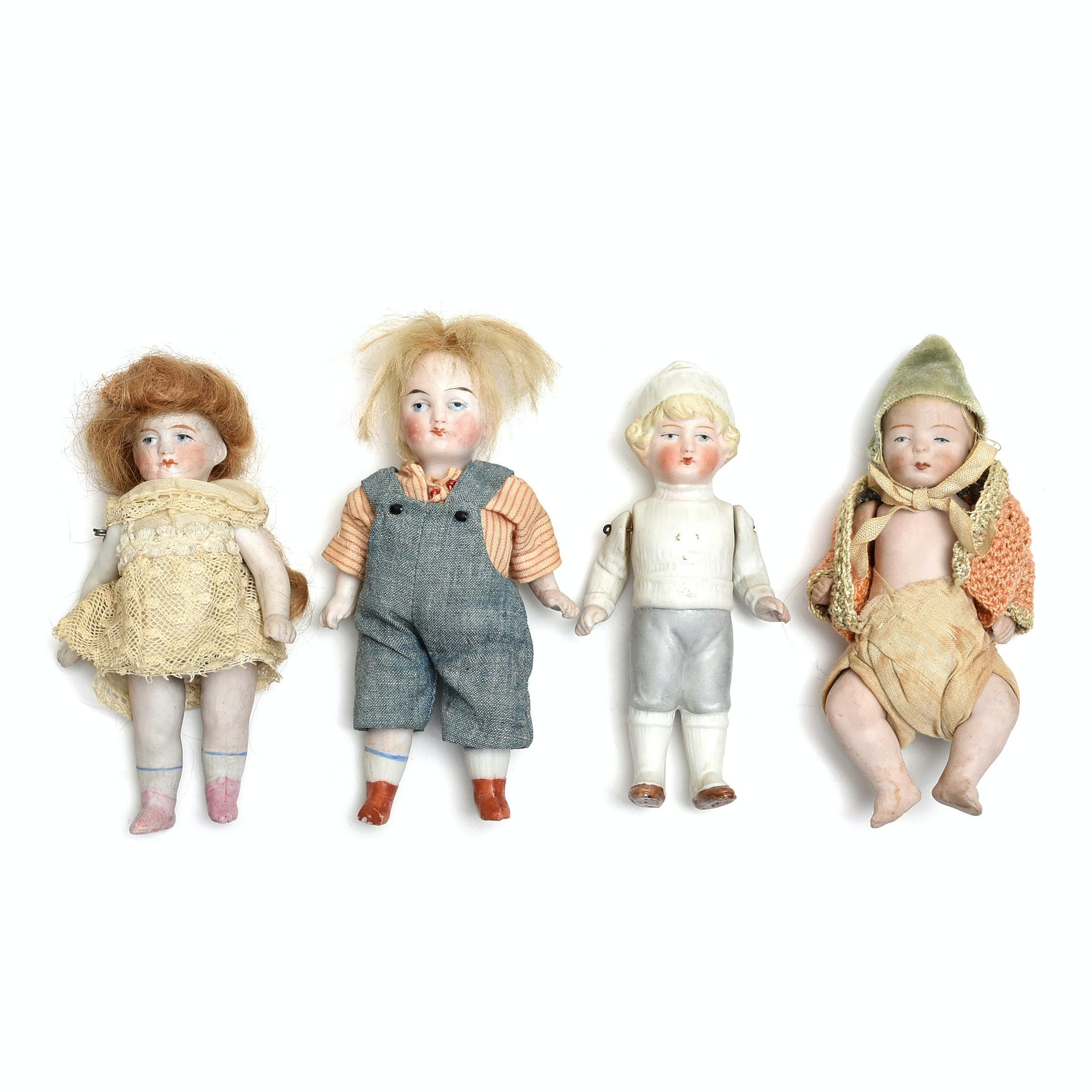 Four Small Vintage Bisque Dolls