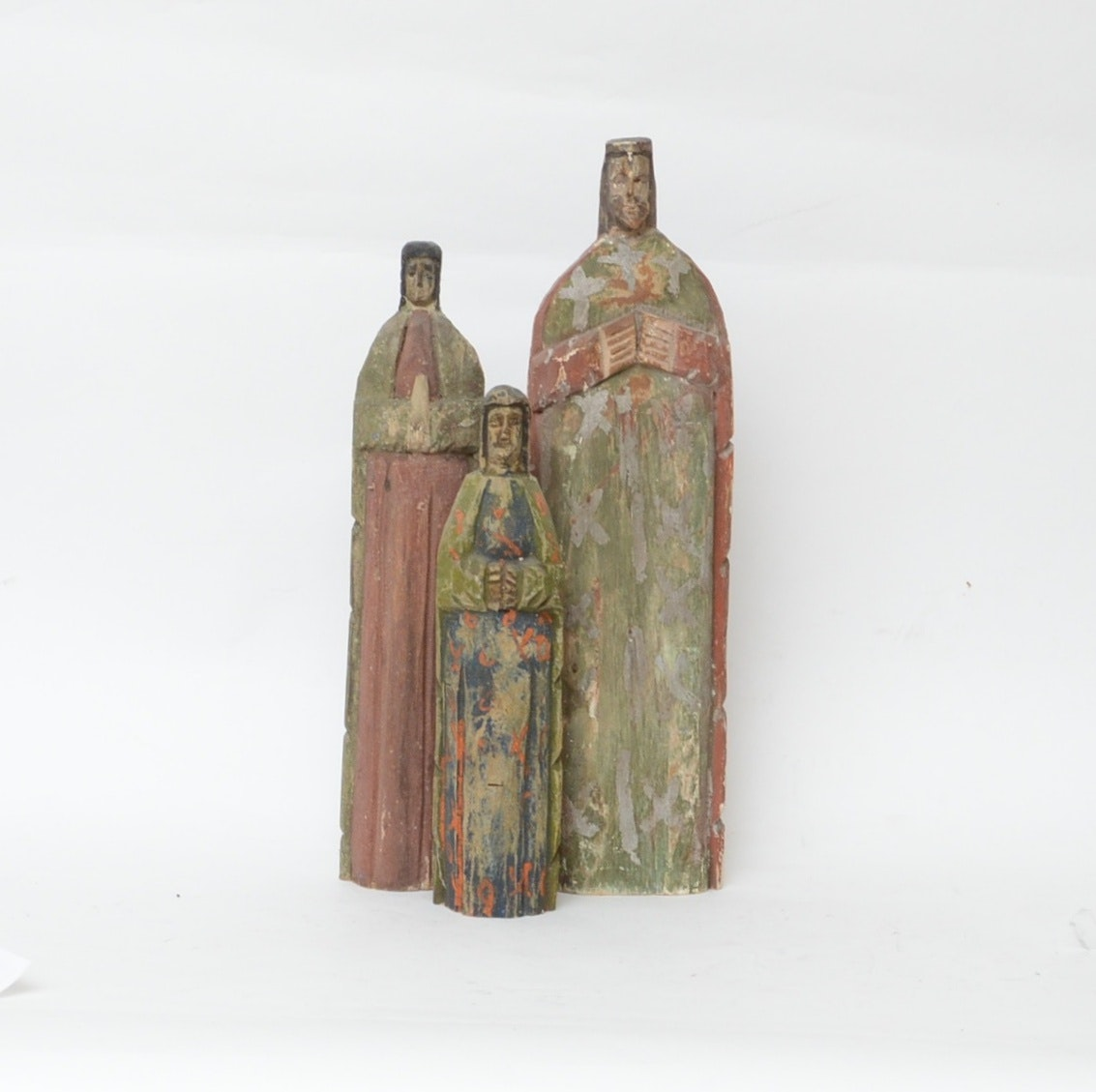 Three Carved and Painted Wooden Santos