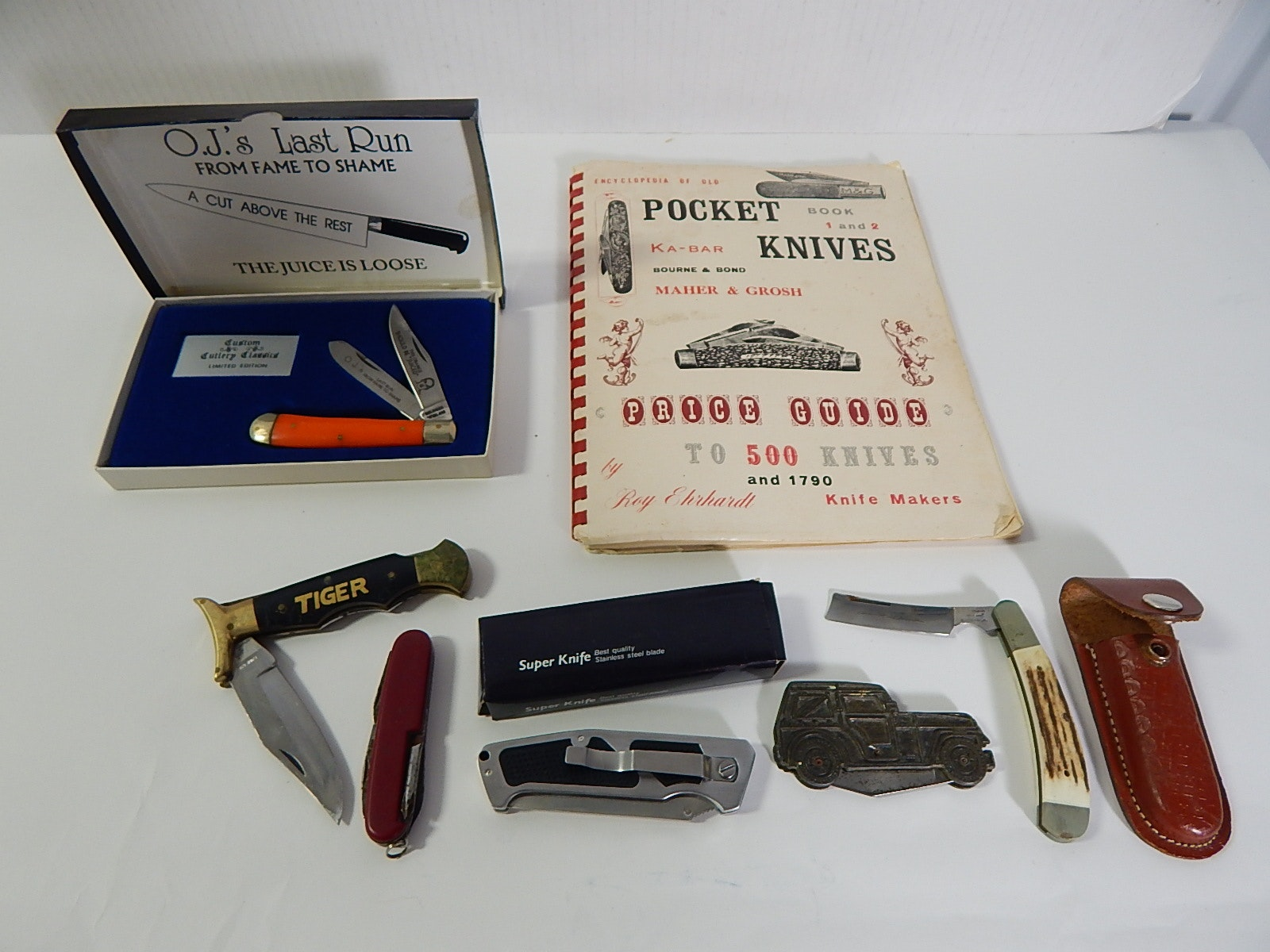 Assorted Pocket Knives and 1974 Pocket Knives Reference Booklet