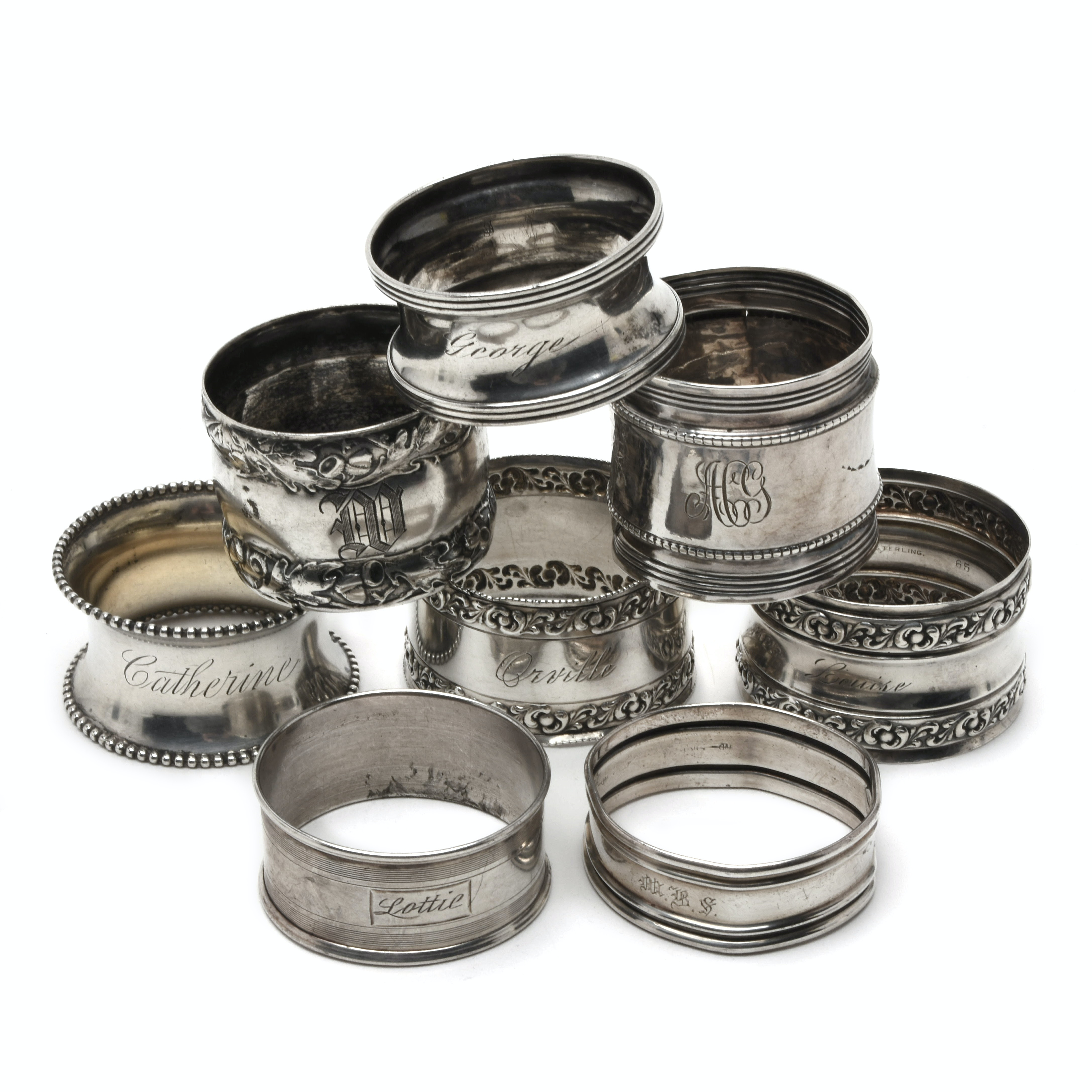 Eight Antique Sterling Silver Napkin Rings Assorted Styles and Makers
