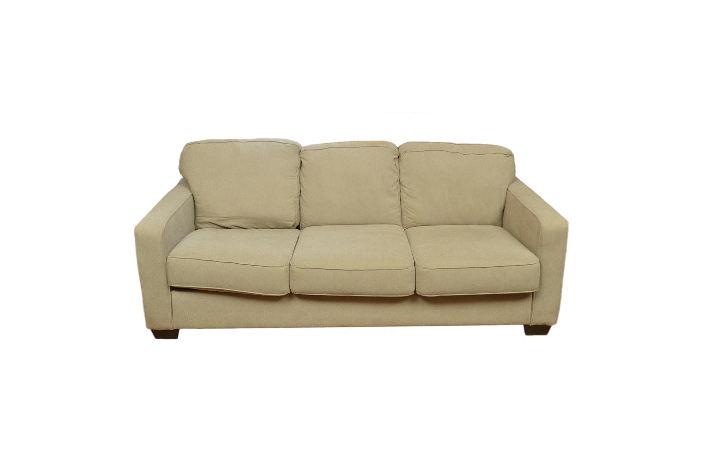 Tan Upholstered Three Cushion Sofa by Ashley Furniture