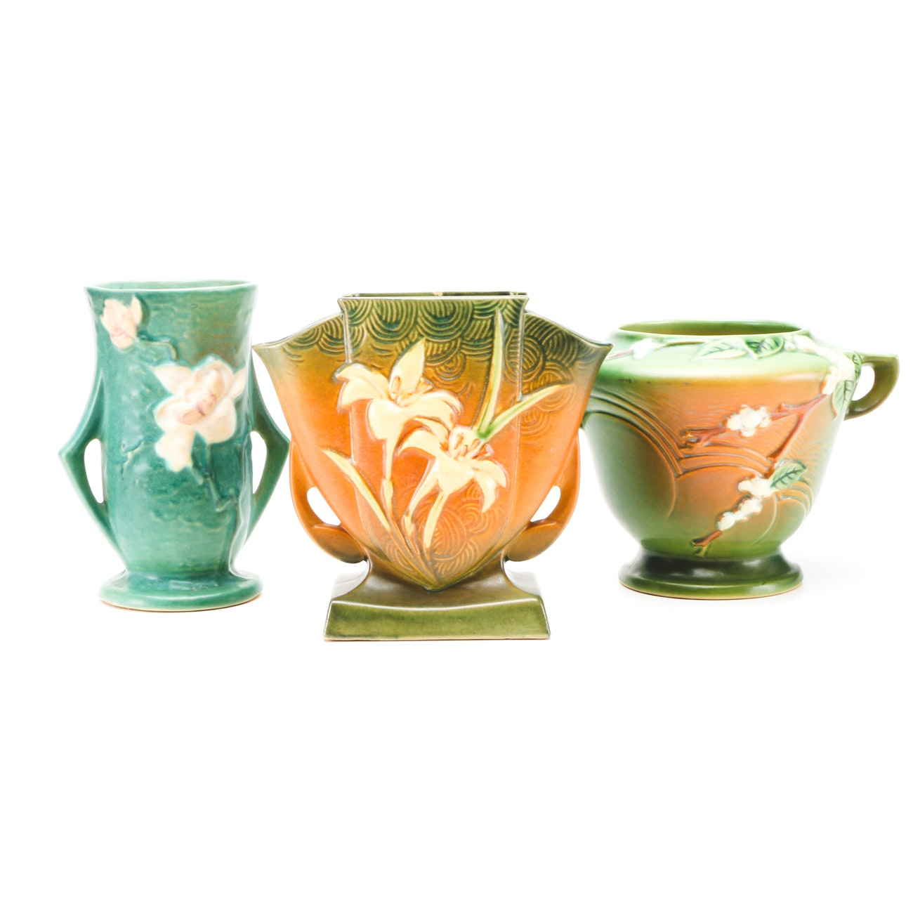 """Roseville """"Magnolia"""", """"Zephyr Lily"""", and """"Snowberry"""" Jardiniere and Vases"""
