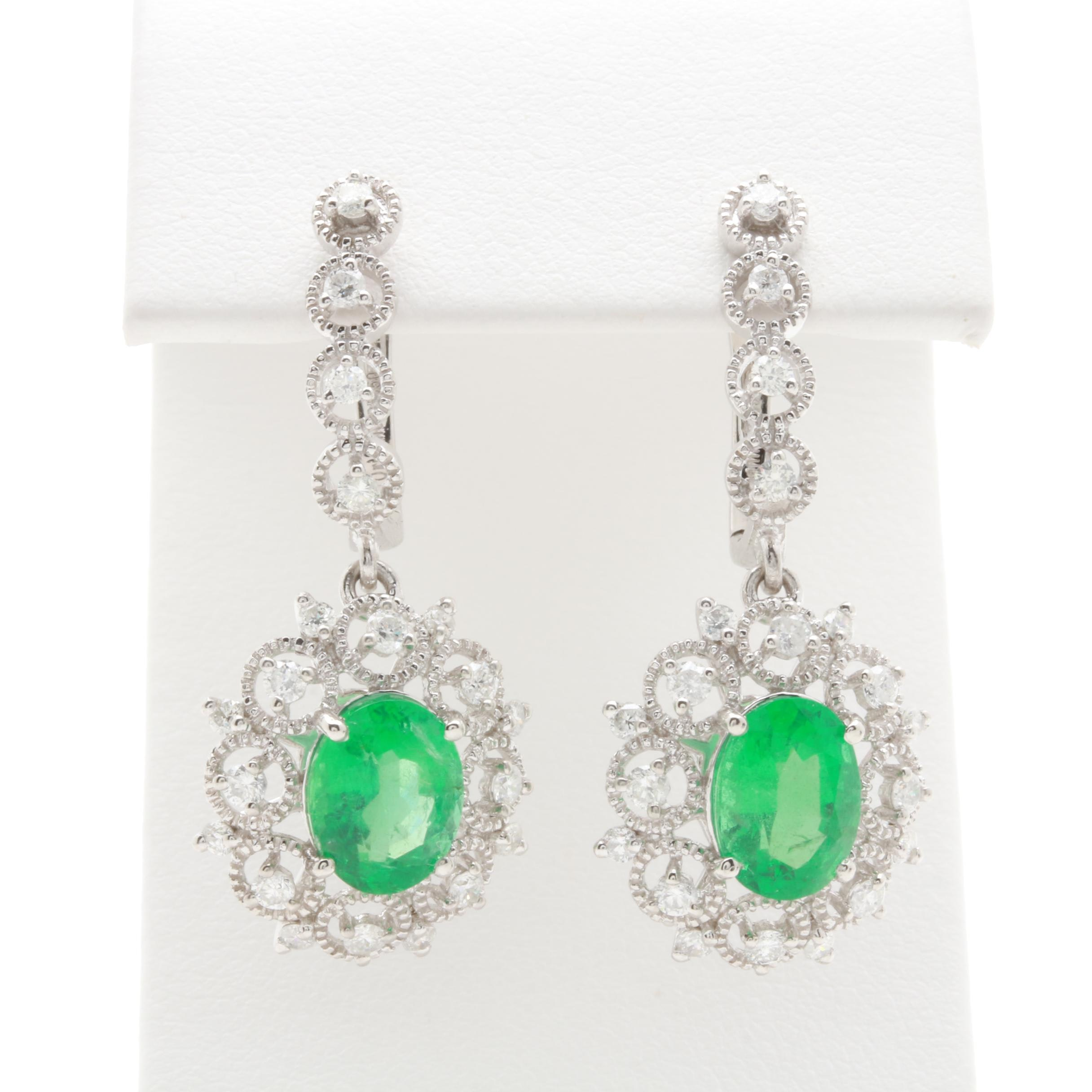 Platinum 3.36 CTW Emerald and 1.00 CTW Diamond Earrings