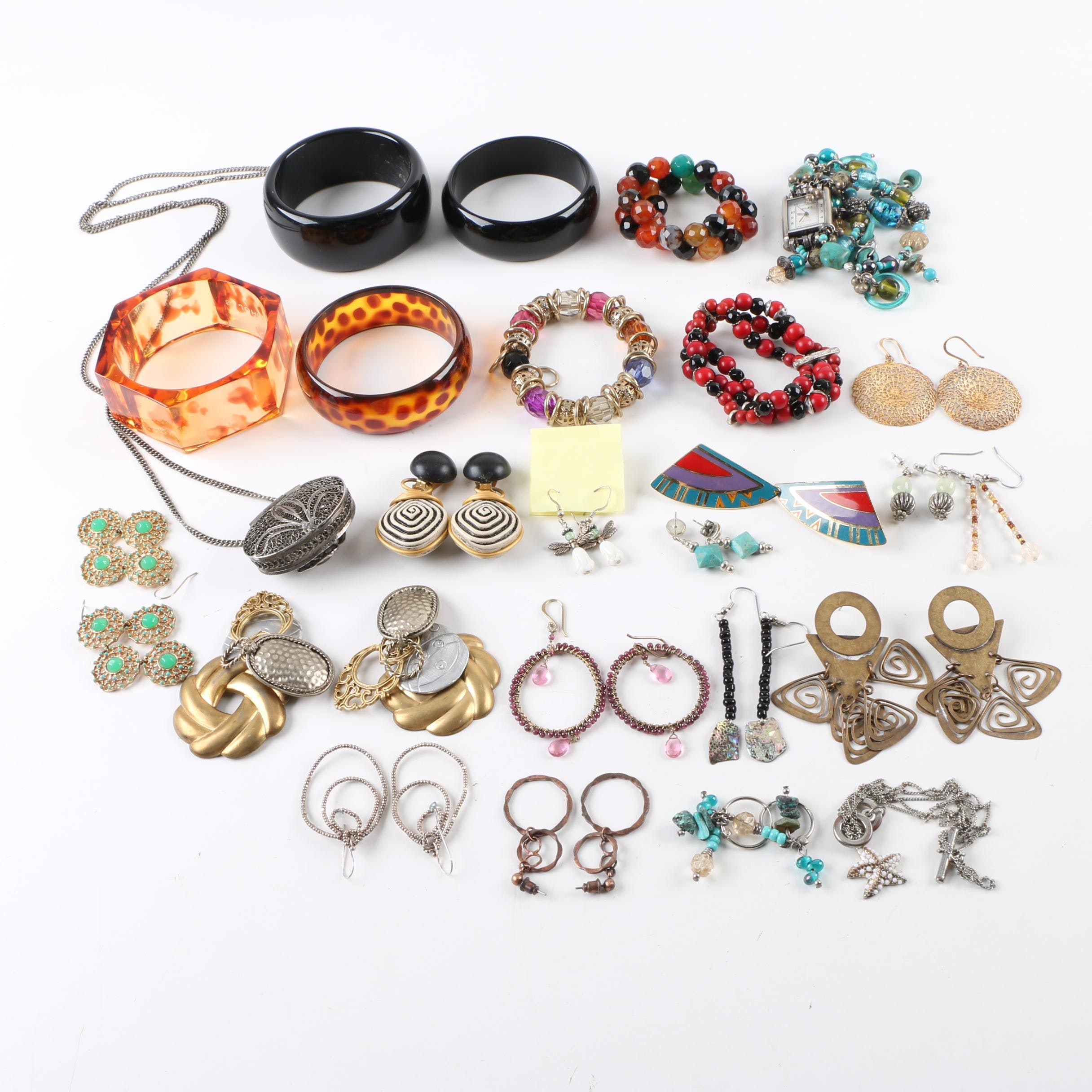 Collection of Jewelry Including Abalone, Sterling Silver, and Glass