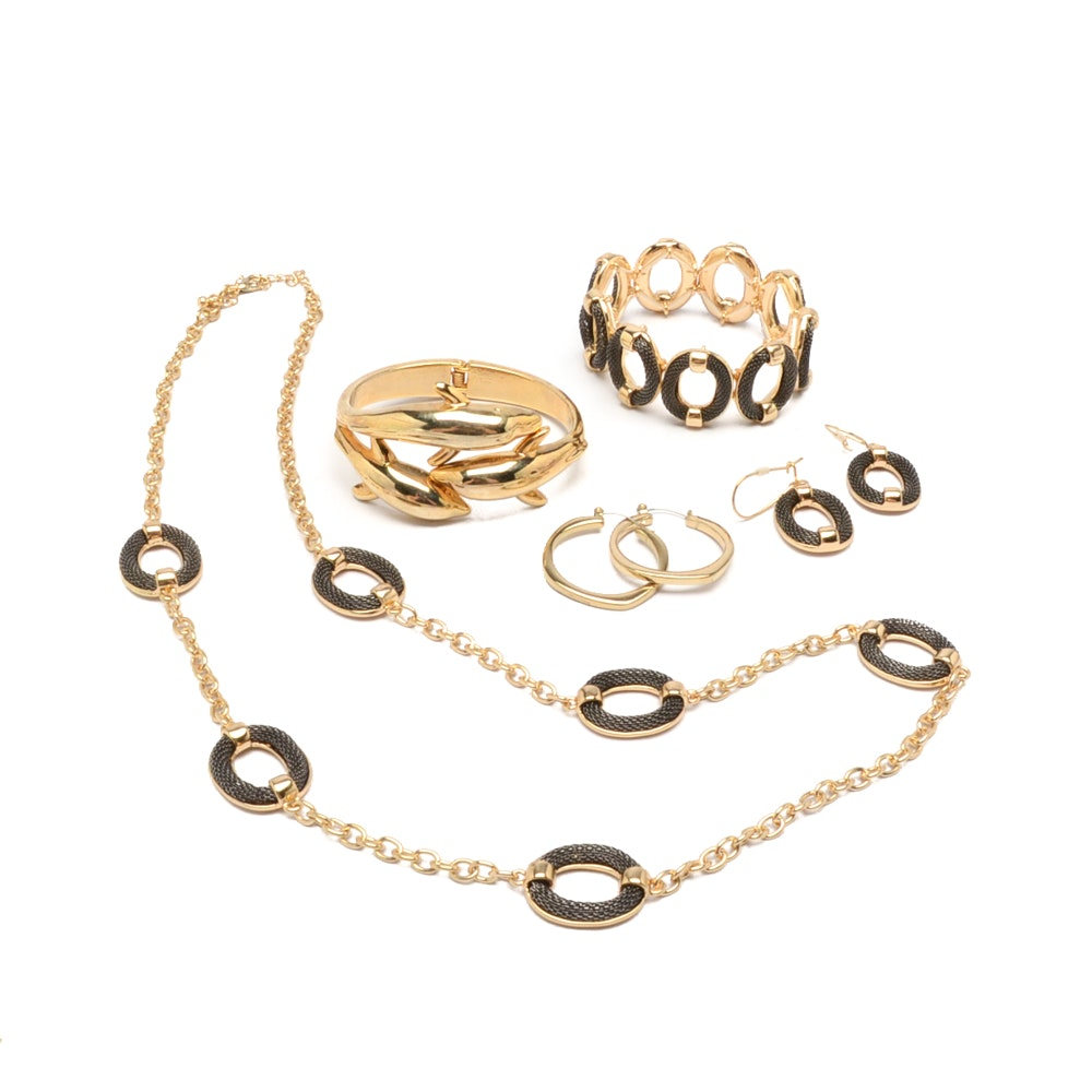 Gold Tone Jewelry Set with a Dolphin Cuff Bracelet and Hoop Earrings