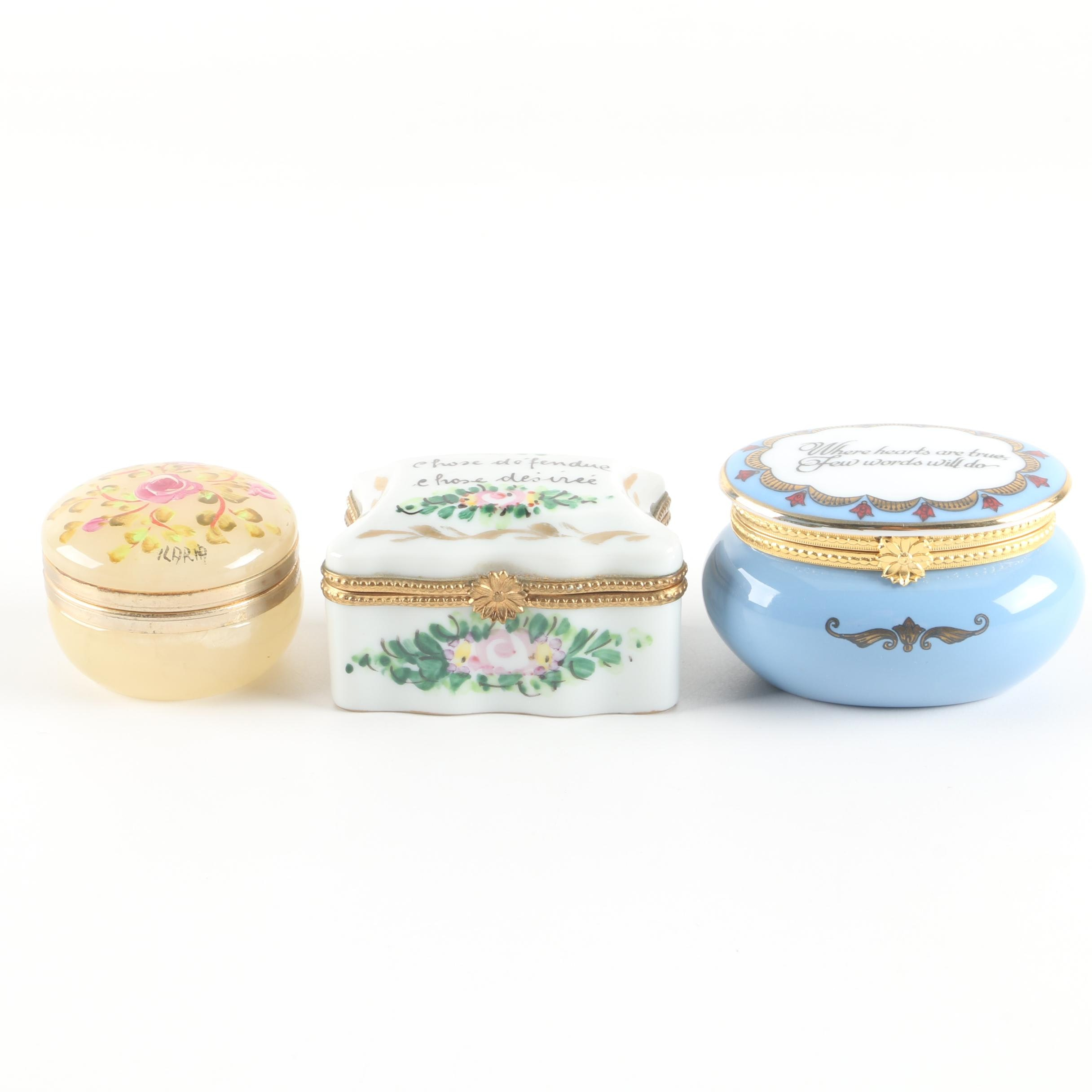 Porcelain and Glass Trinket Boxes Featuring Dewman