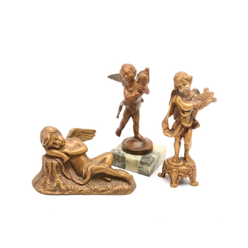 Group of Brass Cherub Figurines