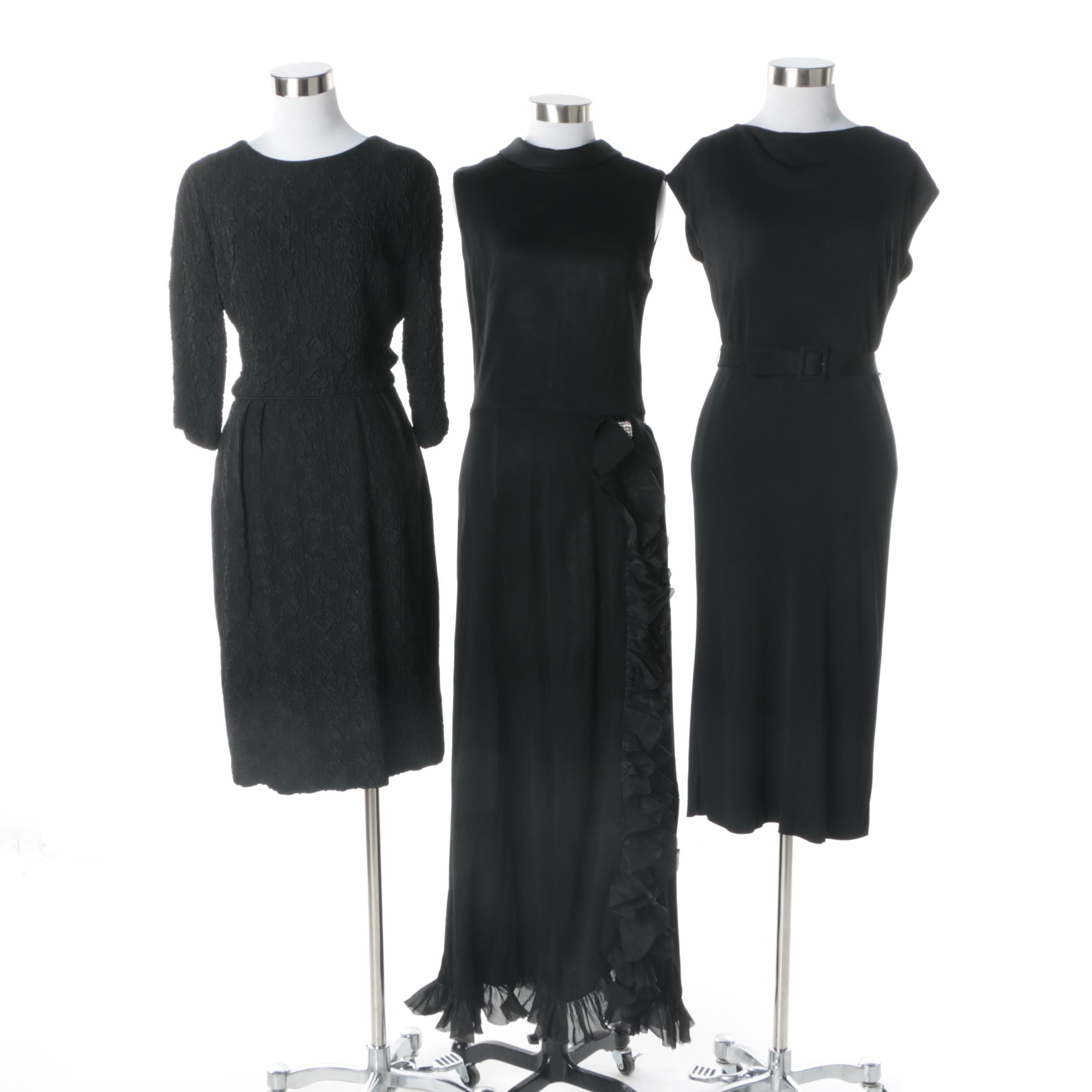 1960s and 1970s Vintage Slinky Black Cocktail Dresses