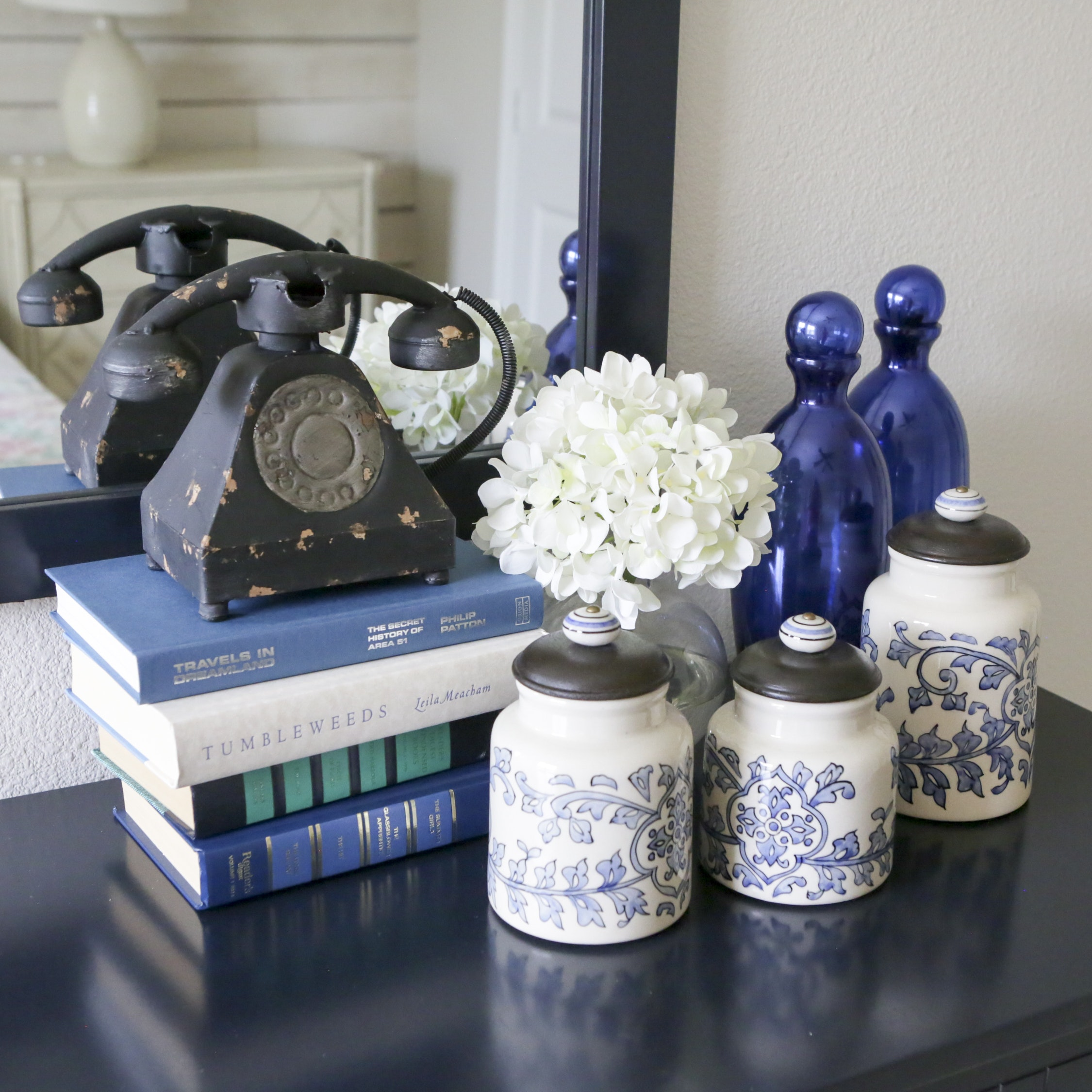 Ceramic Canisters, Blue Glass Bottles, Decorative Books, and Other Decor