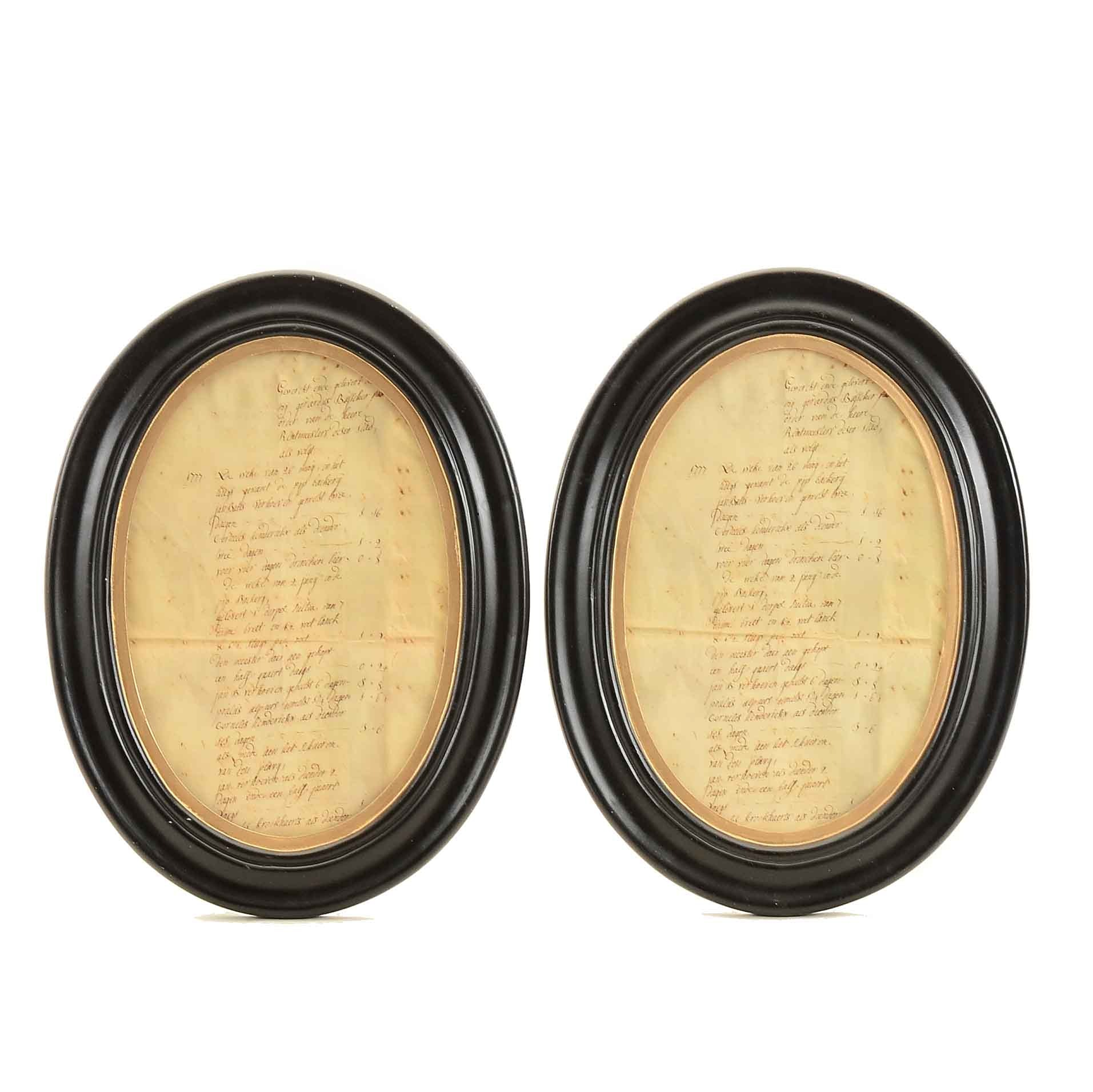 Pair of Ebonized and Gilded Wooden Frame Oval Frames