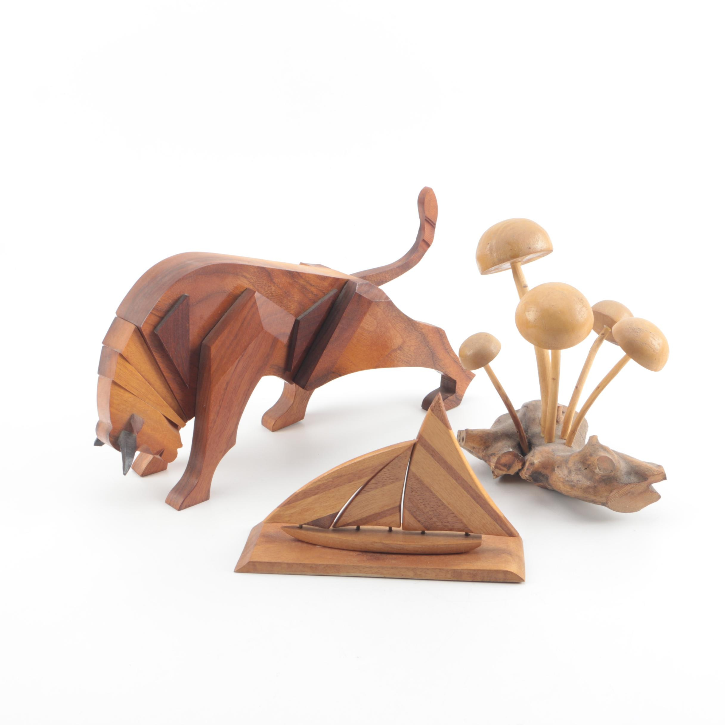 Wooden Sculptures including a Schooner, Mushrooms, and a Bull