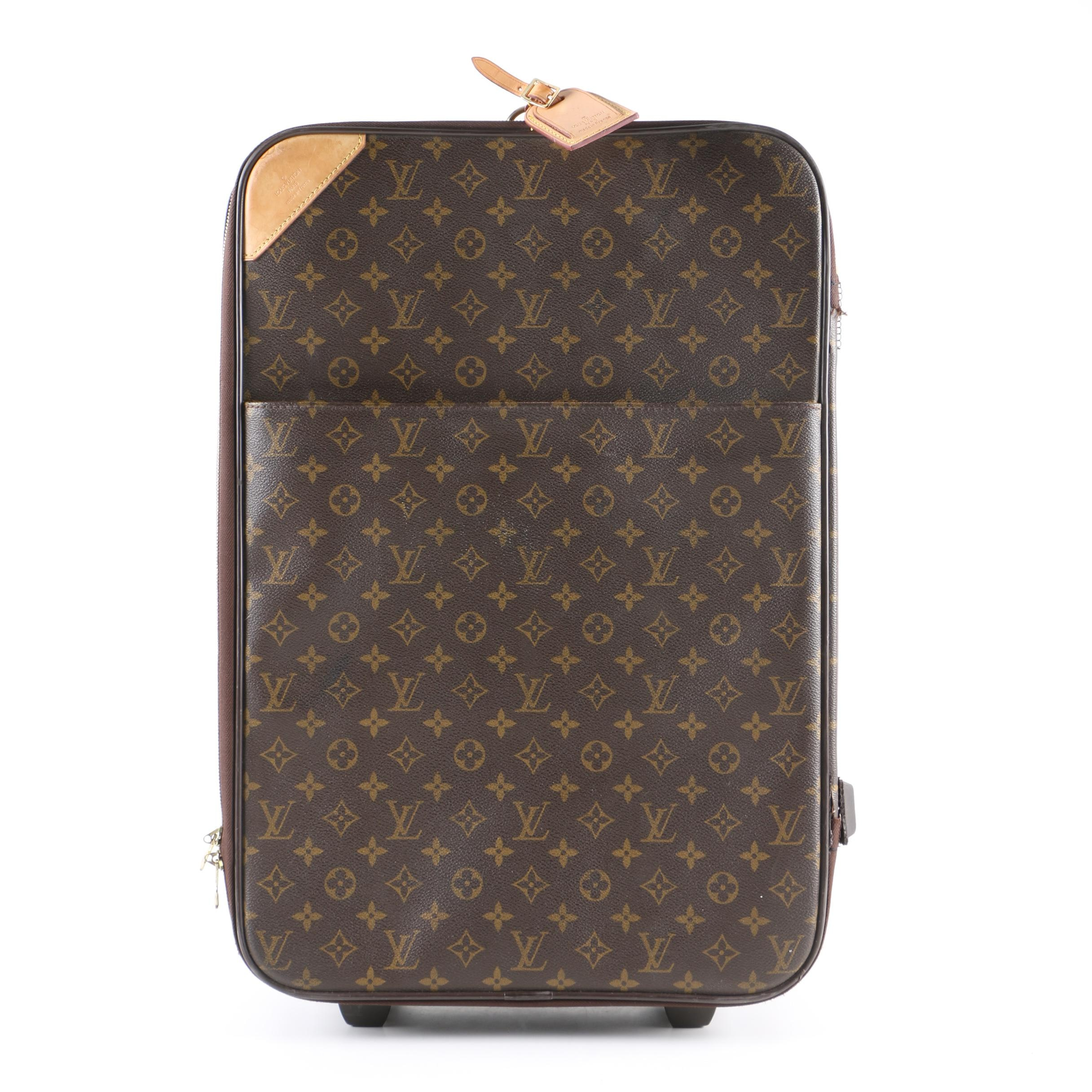 Louis Vuitton of Paris Monogram Coated Canvas Rolling Suitcase