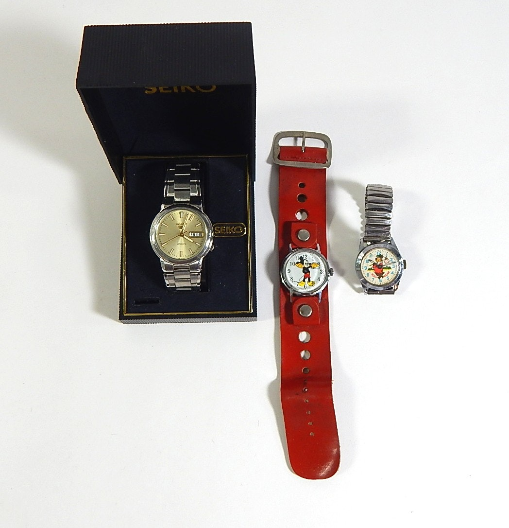Three Wristwatches with Mickey Mouse and Seiko