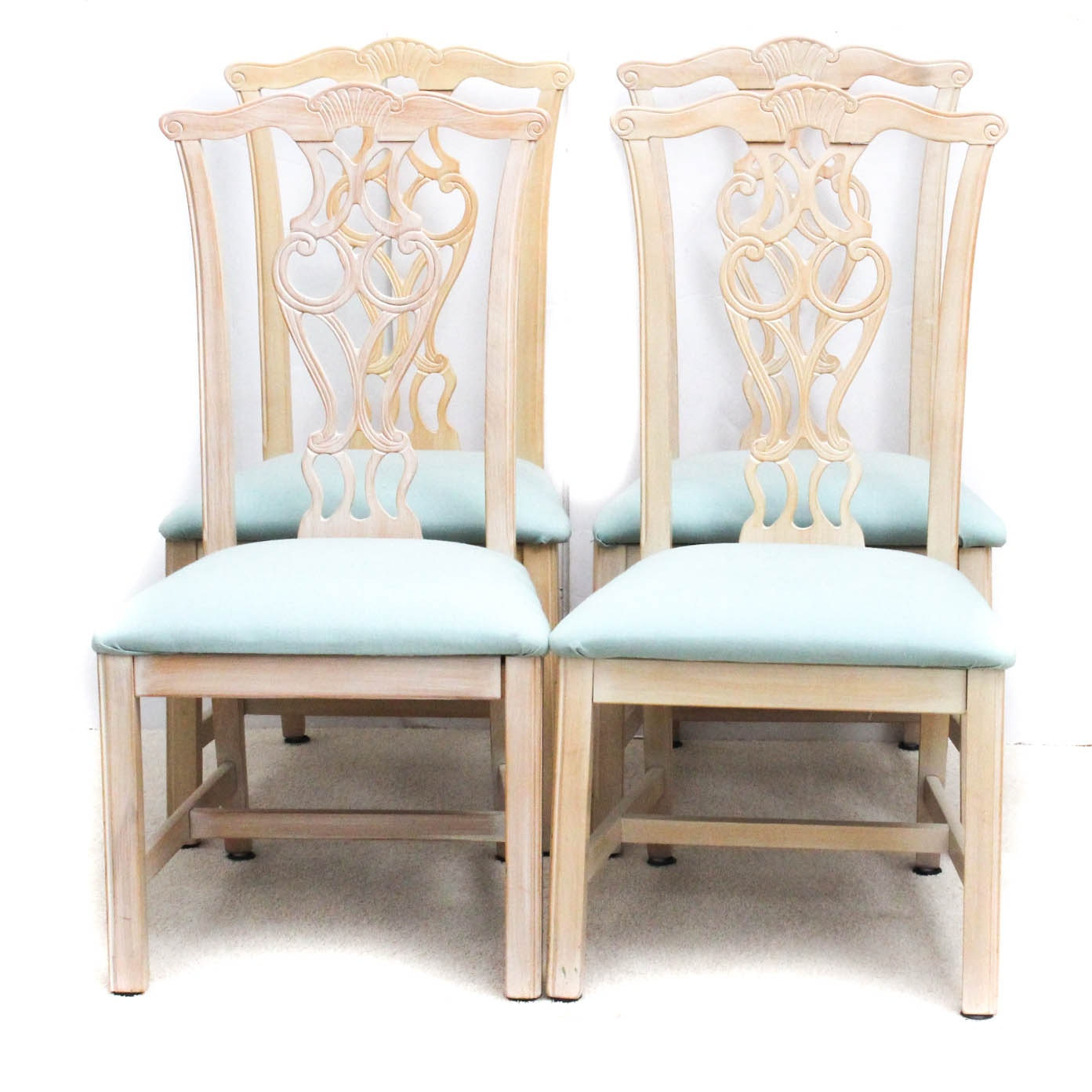 Four Carved Wood Dining Chairs