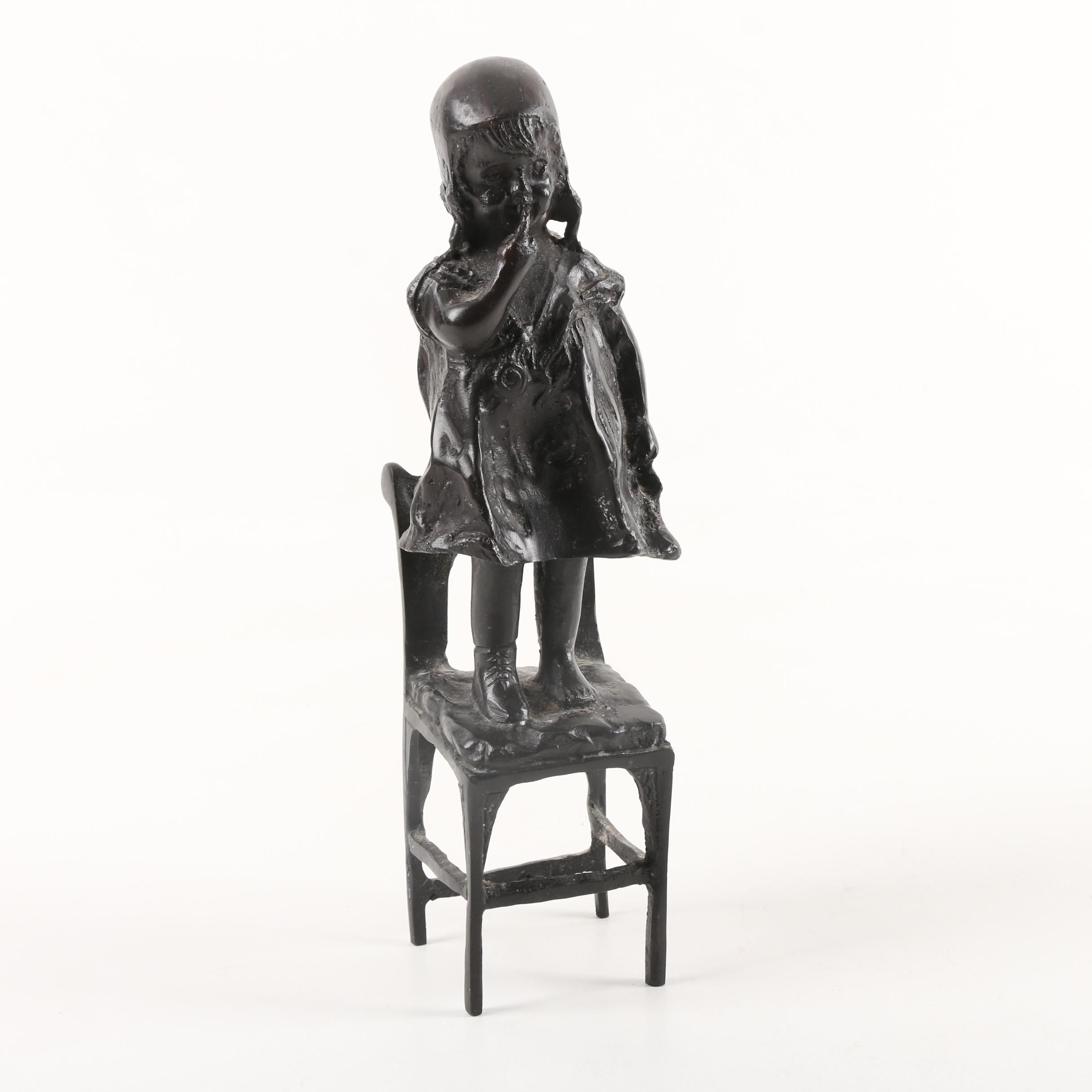 Vintage Cast Metal Figurine of Girl on Chair