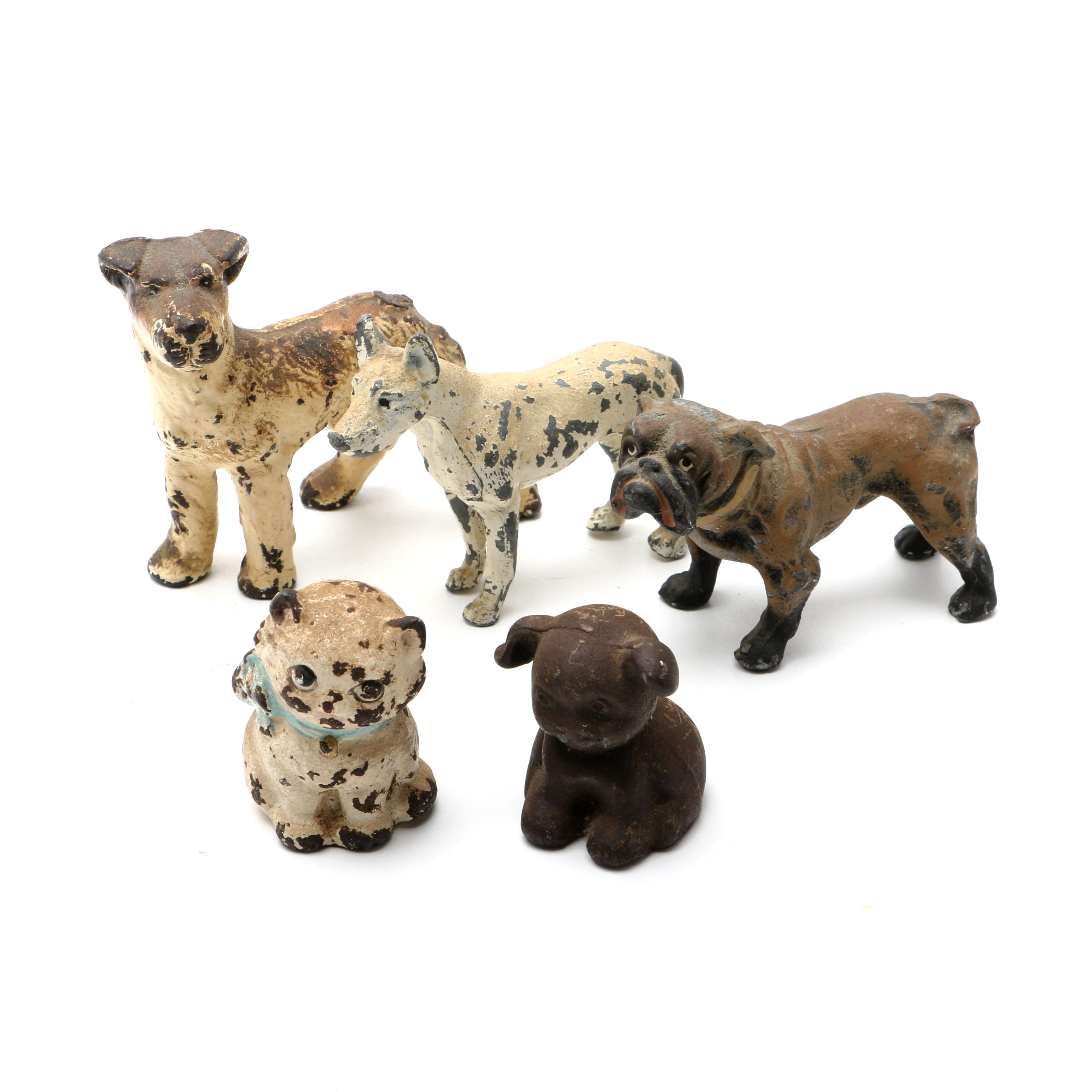 Group Of Five Small Cast Metal Dogs