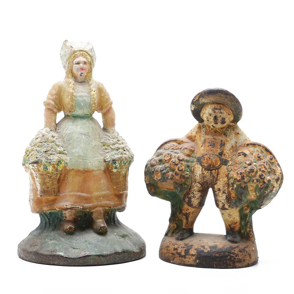 Two Figural Cast-Iron Doorstops, Figures With Flower Baskets