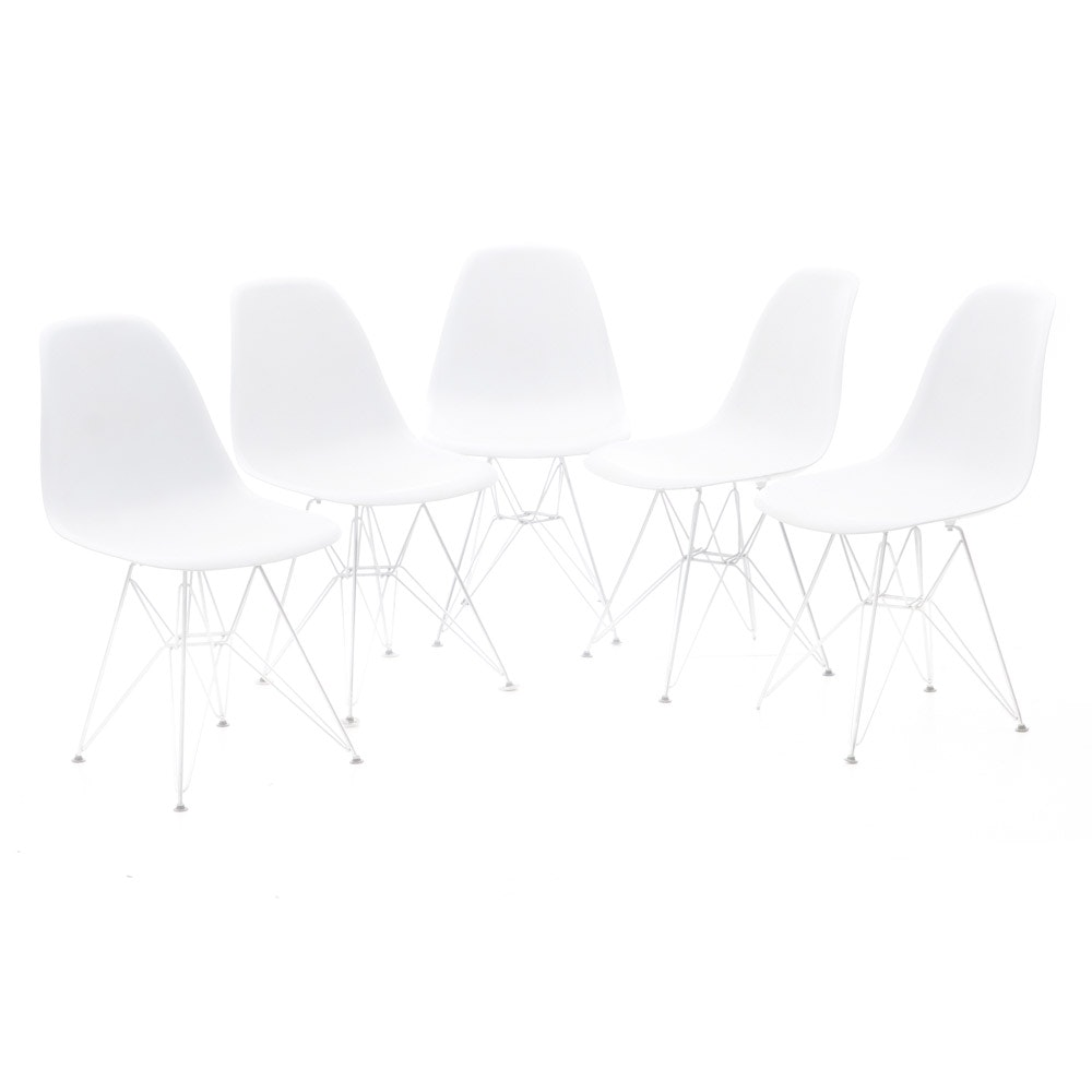 Five White Molded Eames Style Chairs