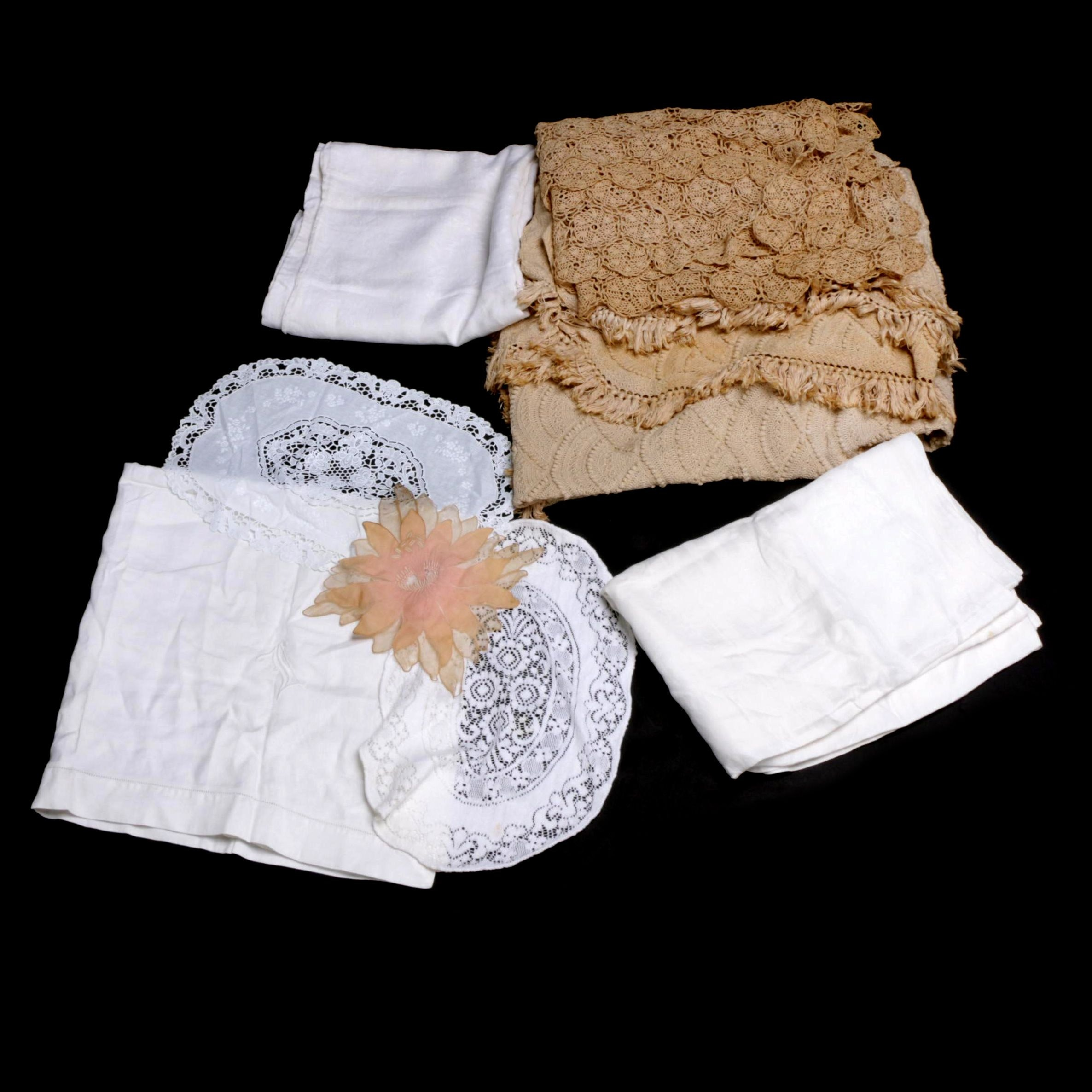 Vintage Bedding and Table Linens Including Crocheted Throw and Lace Doilies