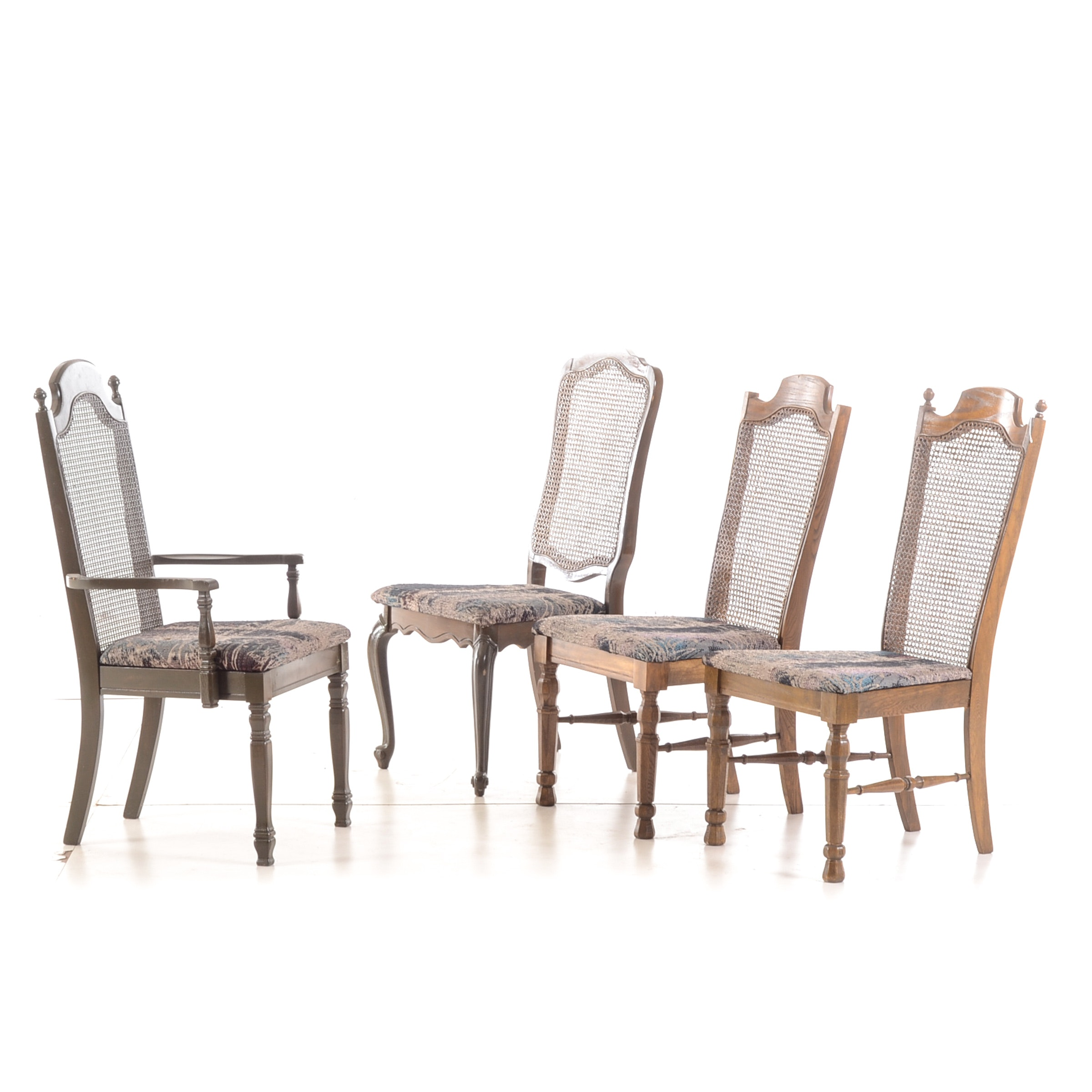 Four Varied Cane-Back Dining Chairs