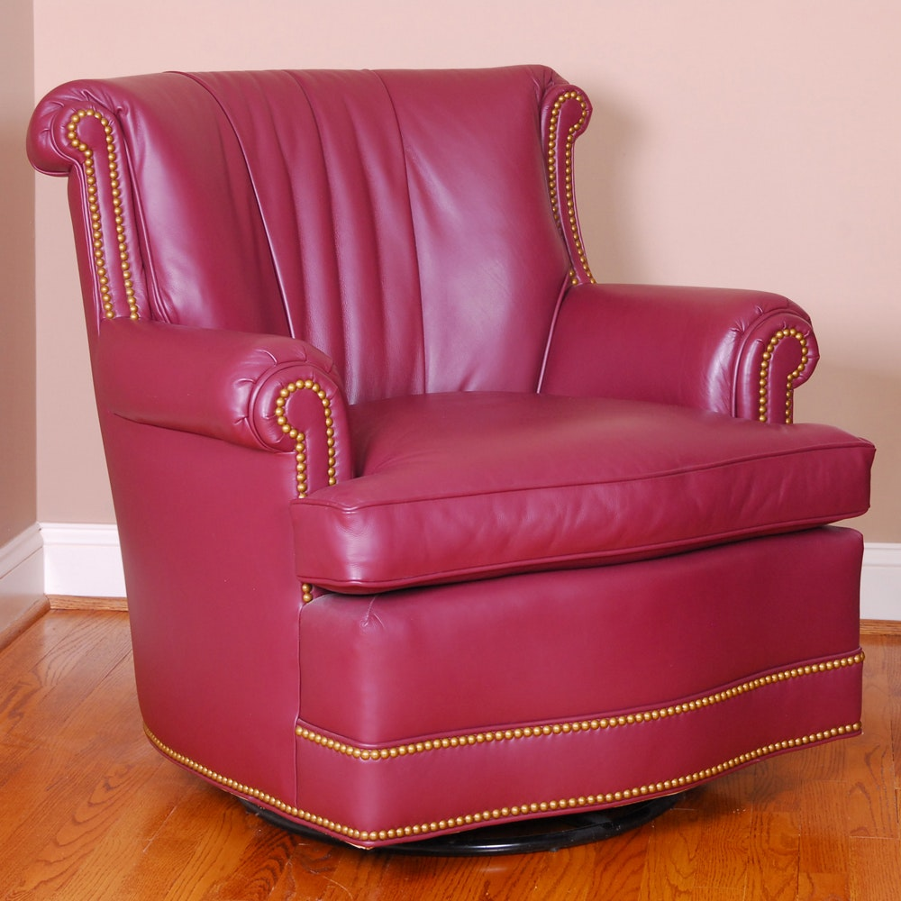 Red Leather Swivel Armchair by Hancock & Moore