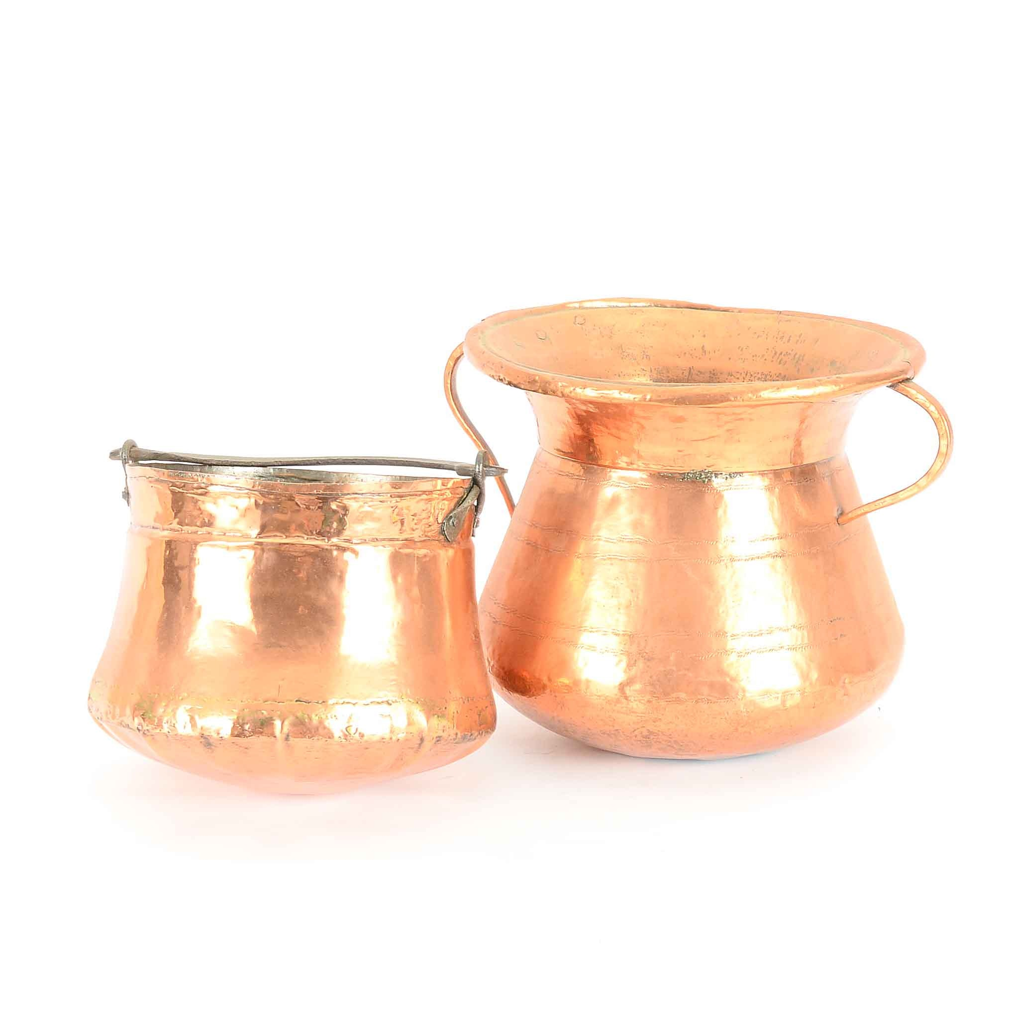 Pair of Copper Urns